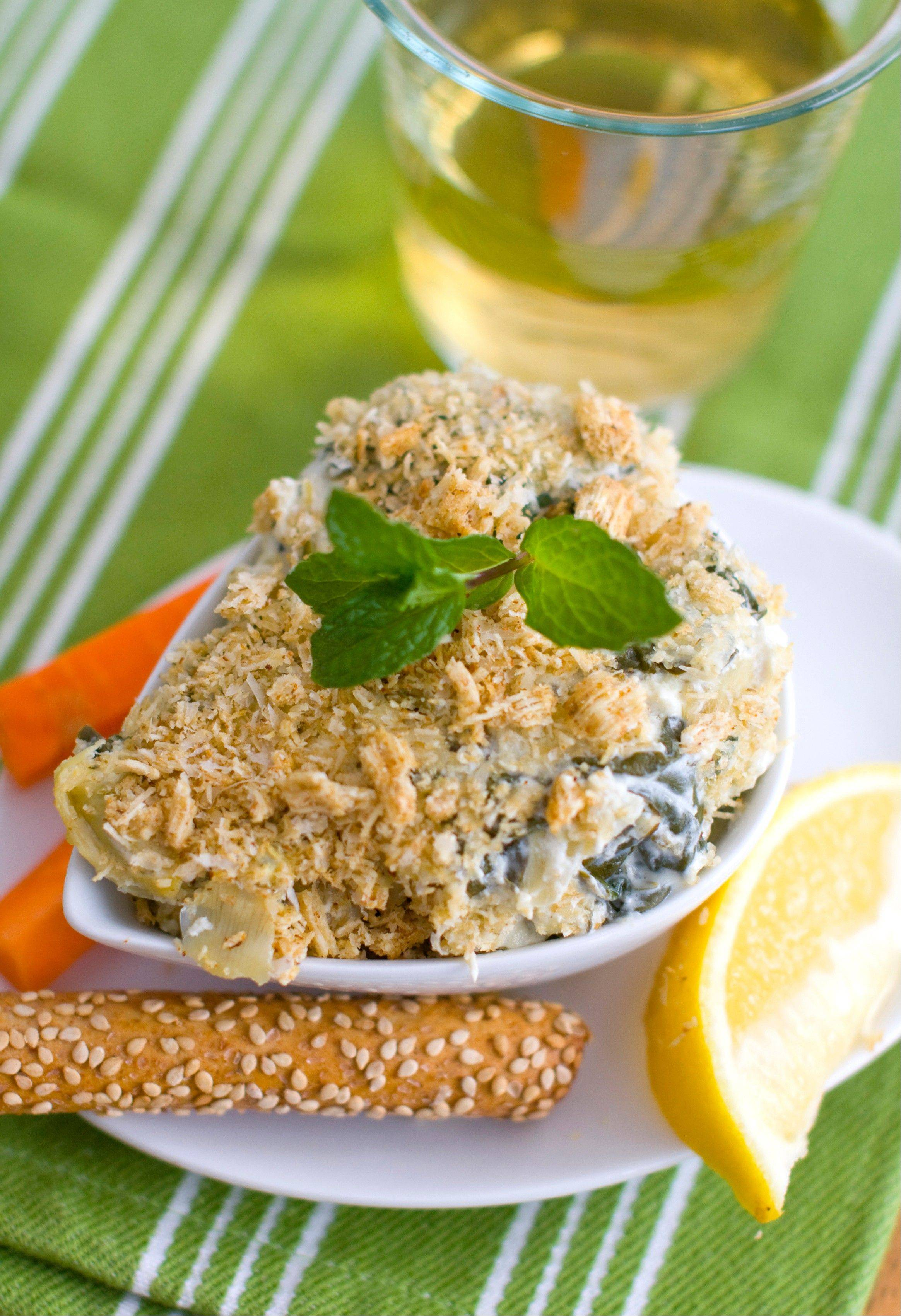 Greek yogurt and low-fat cream cheese help slim down spinach and artichoke dip.