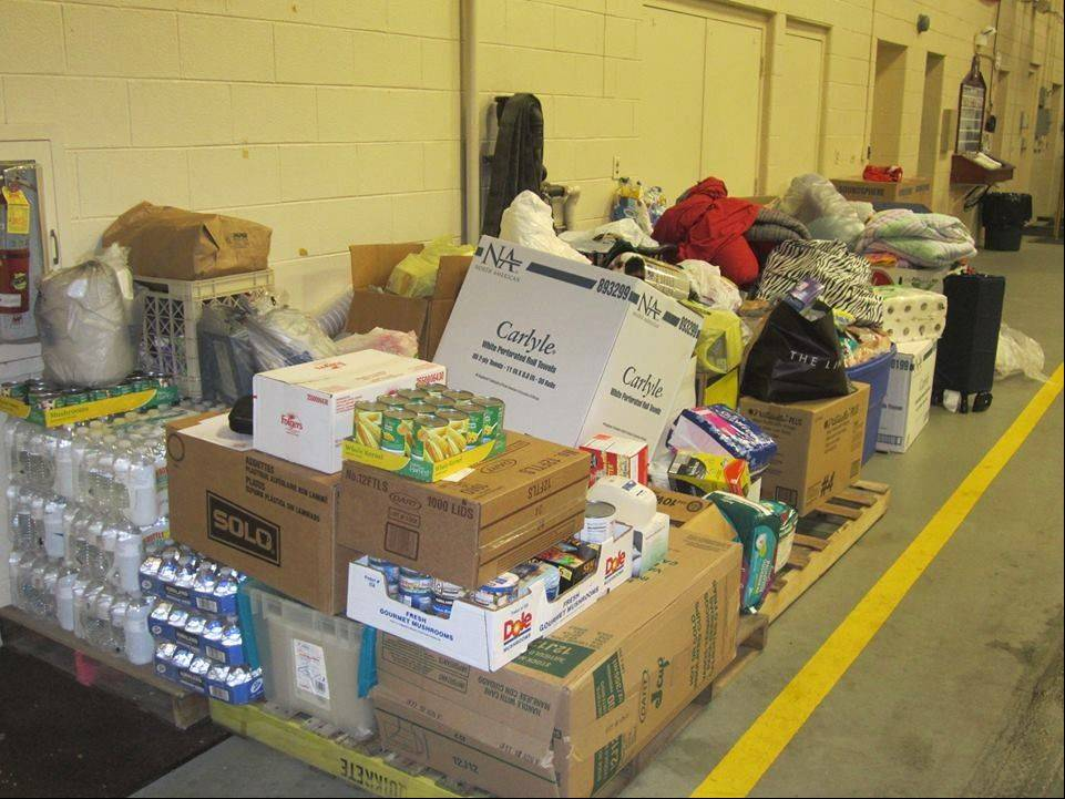 Members of the Lombard Fire Department recently delivered donations to Washington, Ill., to help those who were affected by a November tornado. The donations were gathered for more than two weeks by the village and the International Village apartments.