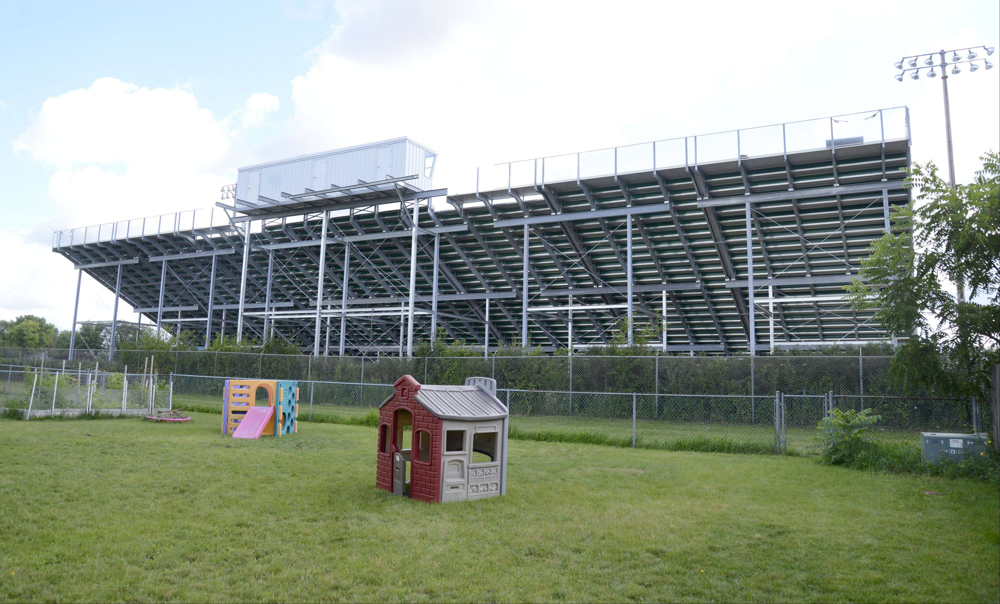 Crystal Lake South High School installed bleachers this summer without the city's approval. Residents who live on Amberwood Drive see the stands loom over their backyards.