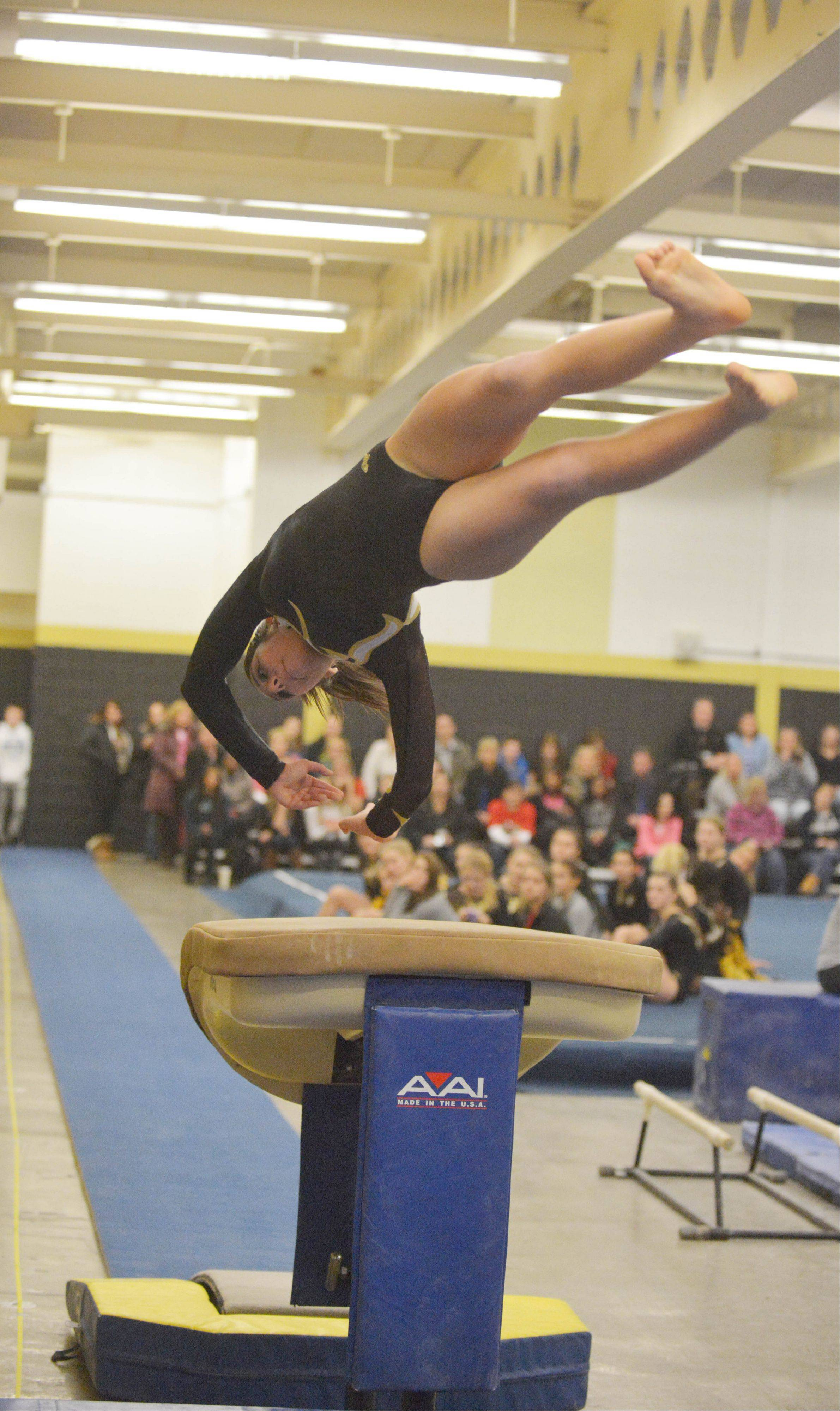 Sofia Colantuono of Glenbard North on the vault during the St. Charles co-op at Glenbard North girls gymnastics meet Wednesday.