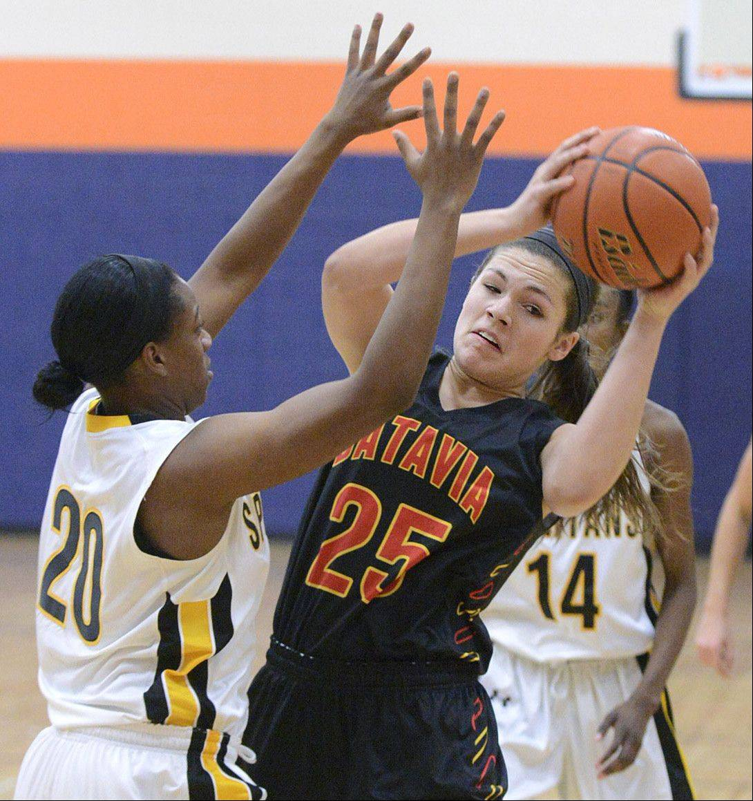 Batavia's Hannah Frazier attempts to pass around Marian Catholic's Dajhae Mullins in the first quarter.