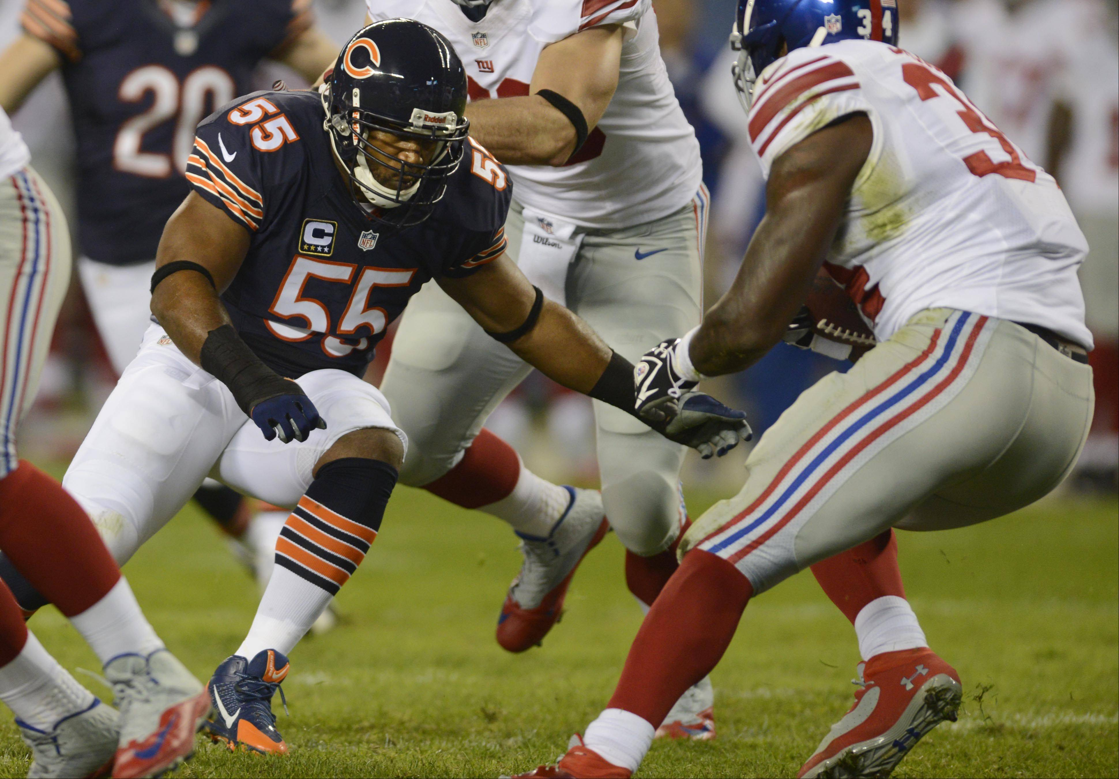 Lance Briggs lines up New York Giants running back Brandon Jacobs earlier this season.