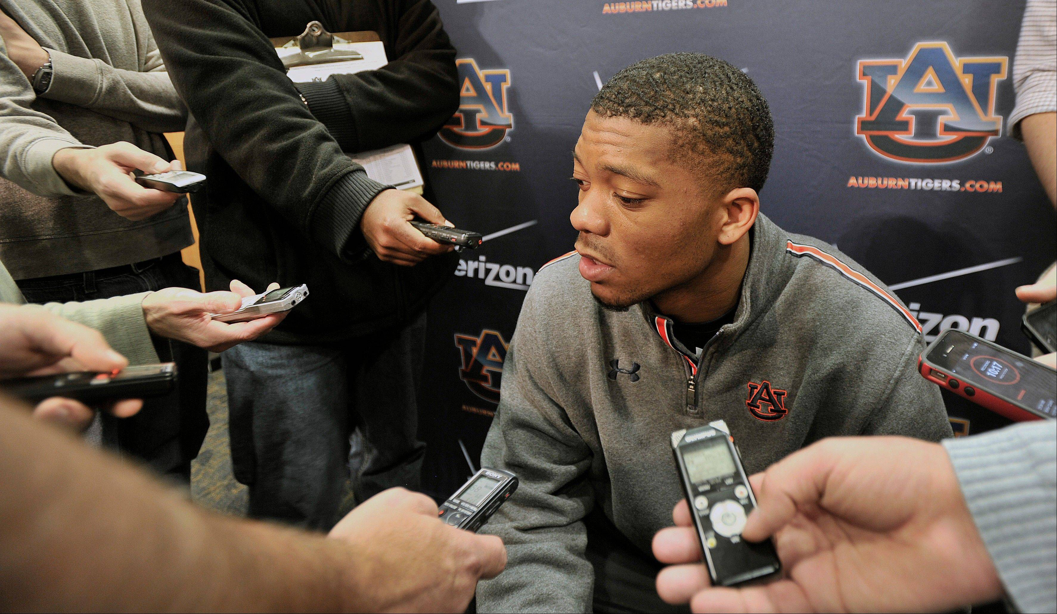 Auburn football quarterback Nick Marshall (14) talks to tmembers of the media on Wednesday in Auburn, Ala.