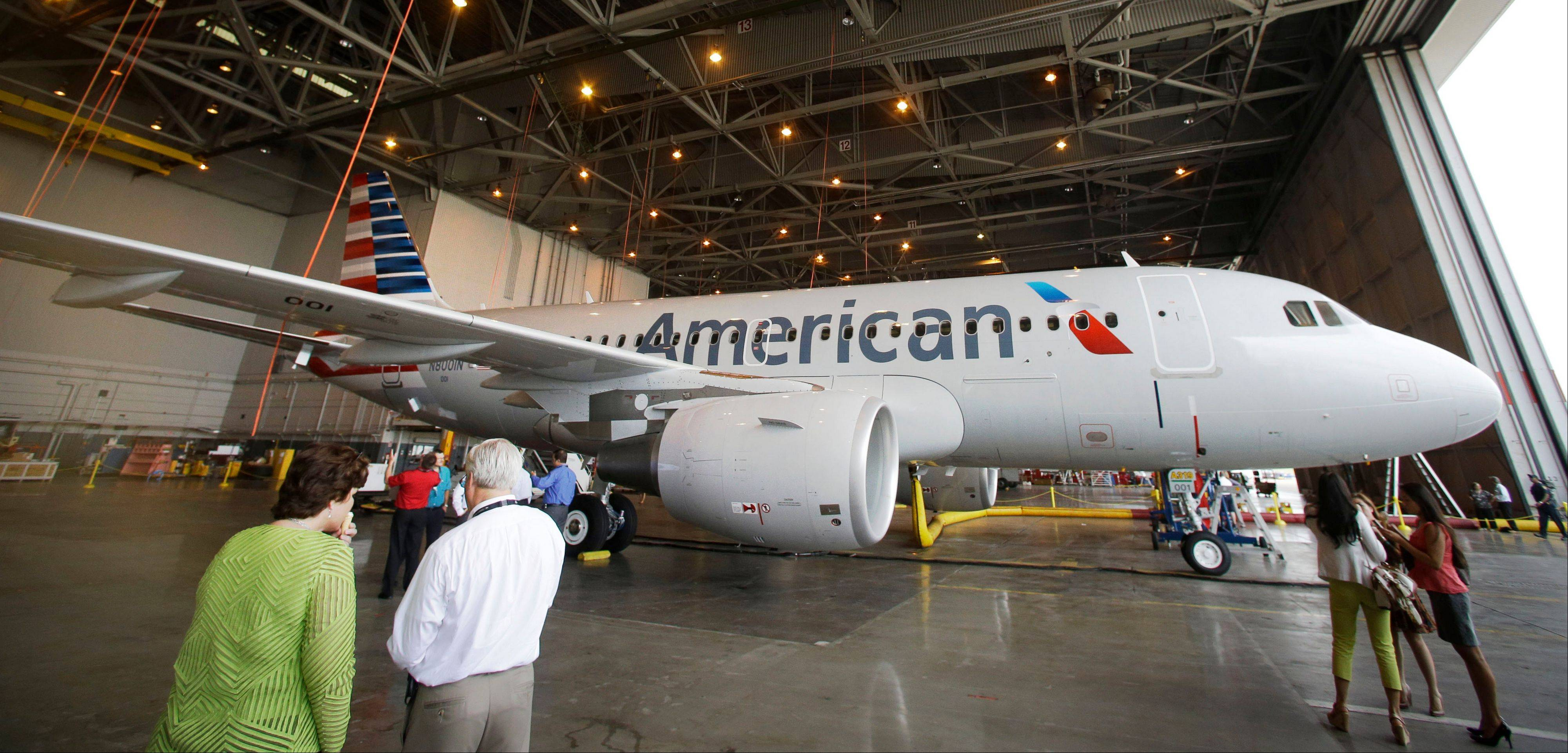 A new American Airlines Airbus A319 aircraft sits in a hanger at Dallas-Forth Worth International Airport, in Grapevine, Texas. Even as they try desperately to hang on to Boeing Co., Washington state officials are quietly courting the company's main competitor.