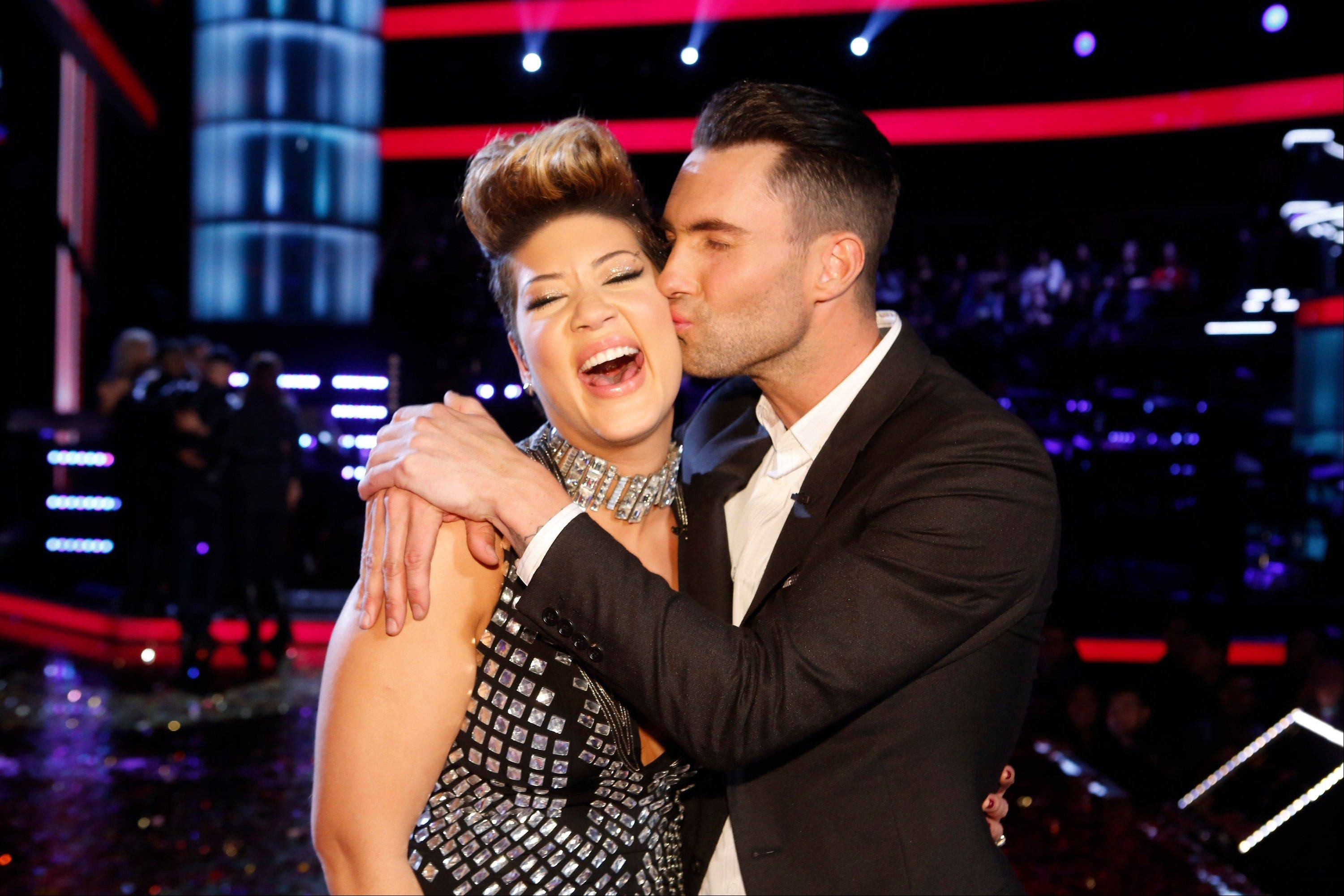 "Maroon 5 frontman Adam Levine kisses Tessanne Chin on the cheek after Chin was announced the season five winner of ""The Voice"" on Tuesday, Dec. 17, 2013, in Los Angeles."