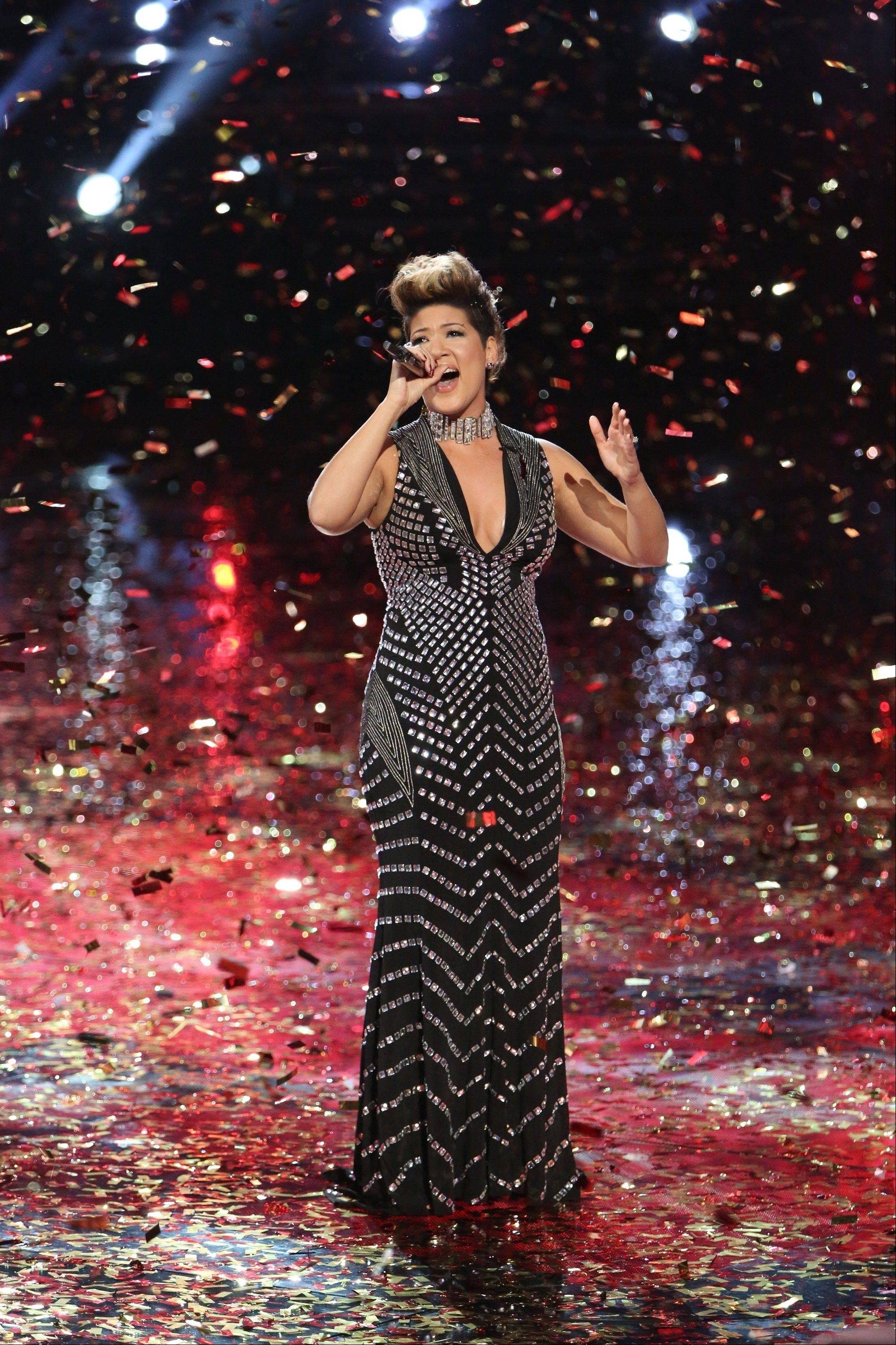 "Tessanne Chin performs after being announced the season five winner of ""The Voice"" on Tuesday. The 28-year-old Kingston native had nearly given up on her dreams before landing a spot on the NBC singing competition."
