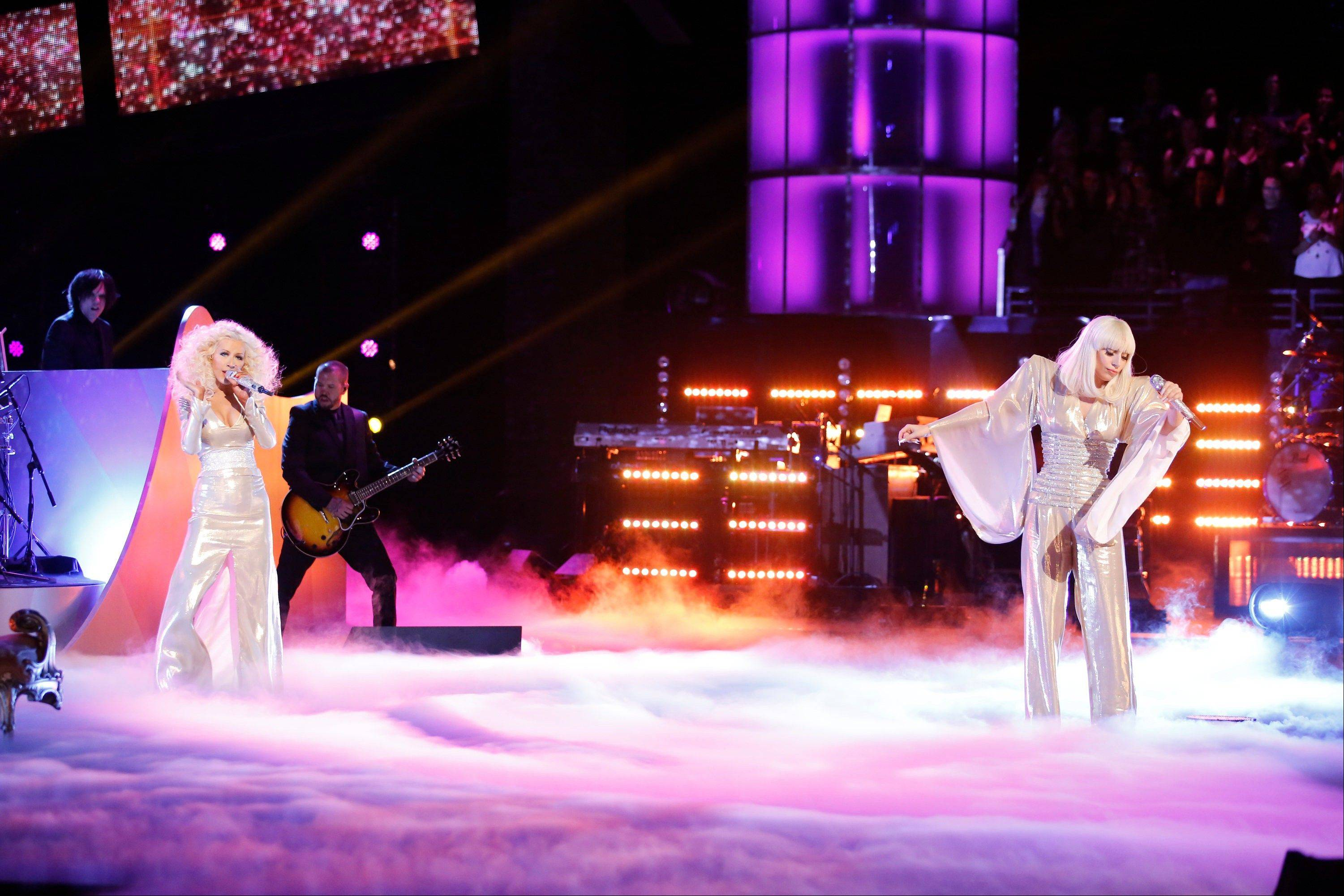 "Christina Aguilera, left, and Lady Gaga perform Gaga's ""Do What U Want"" during the season five finale of ""The Voice"" on Tuesday."