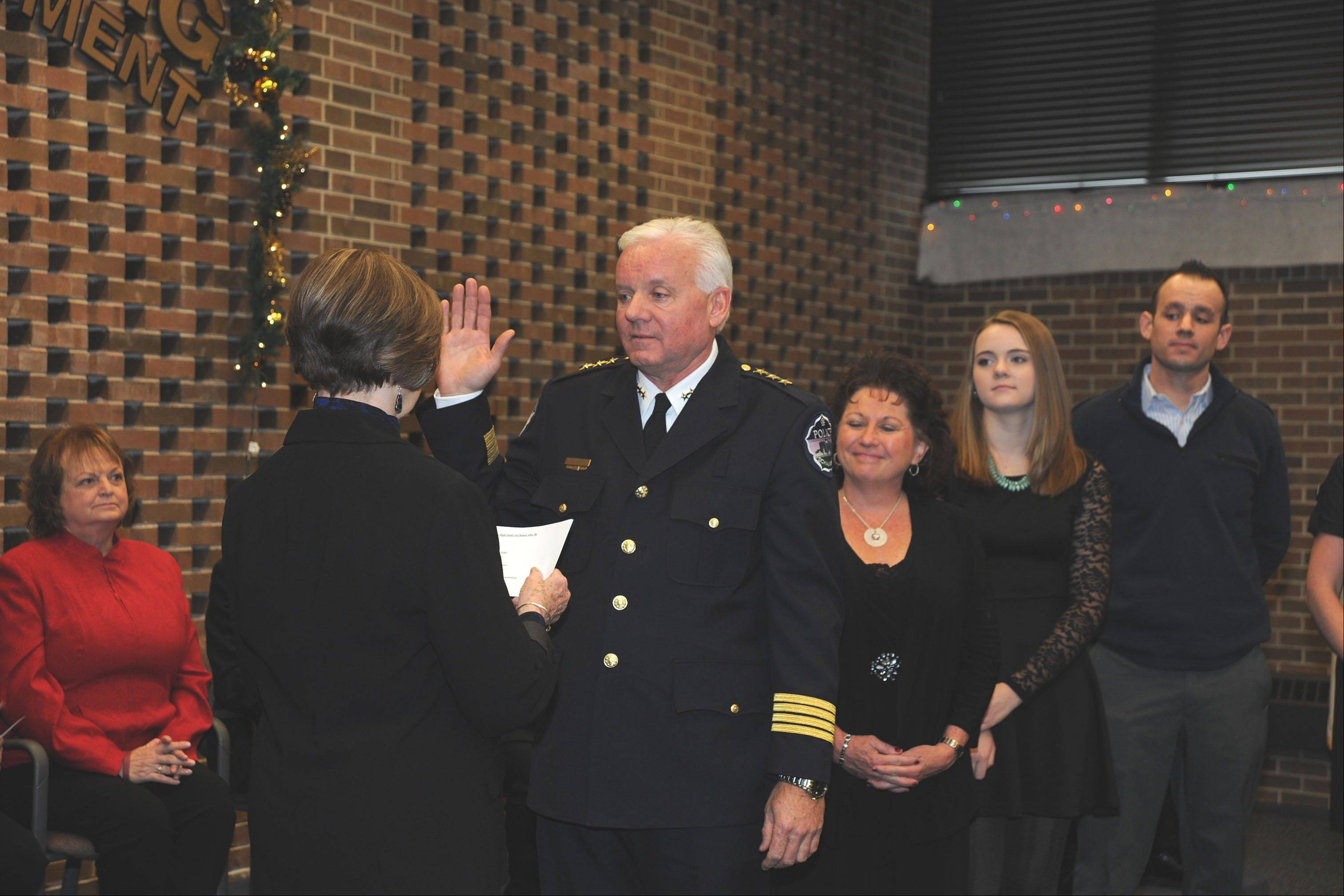 New Schaumburg Police Chief James Lamkin was sworn into office this week by Village Clerk Marilyn Karr as his family looked on. Lamkin, who comes to Schaumburg after a decade as St. Charles' police chief, officially assumes his duties Dec. 30.