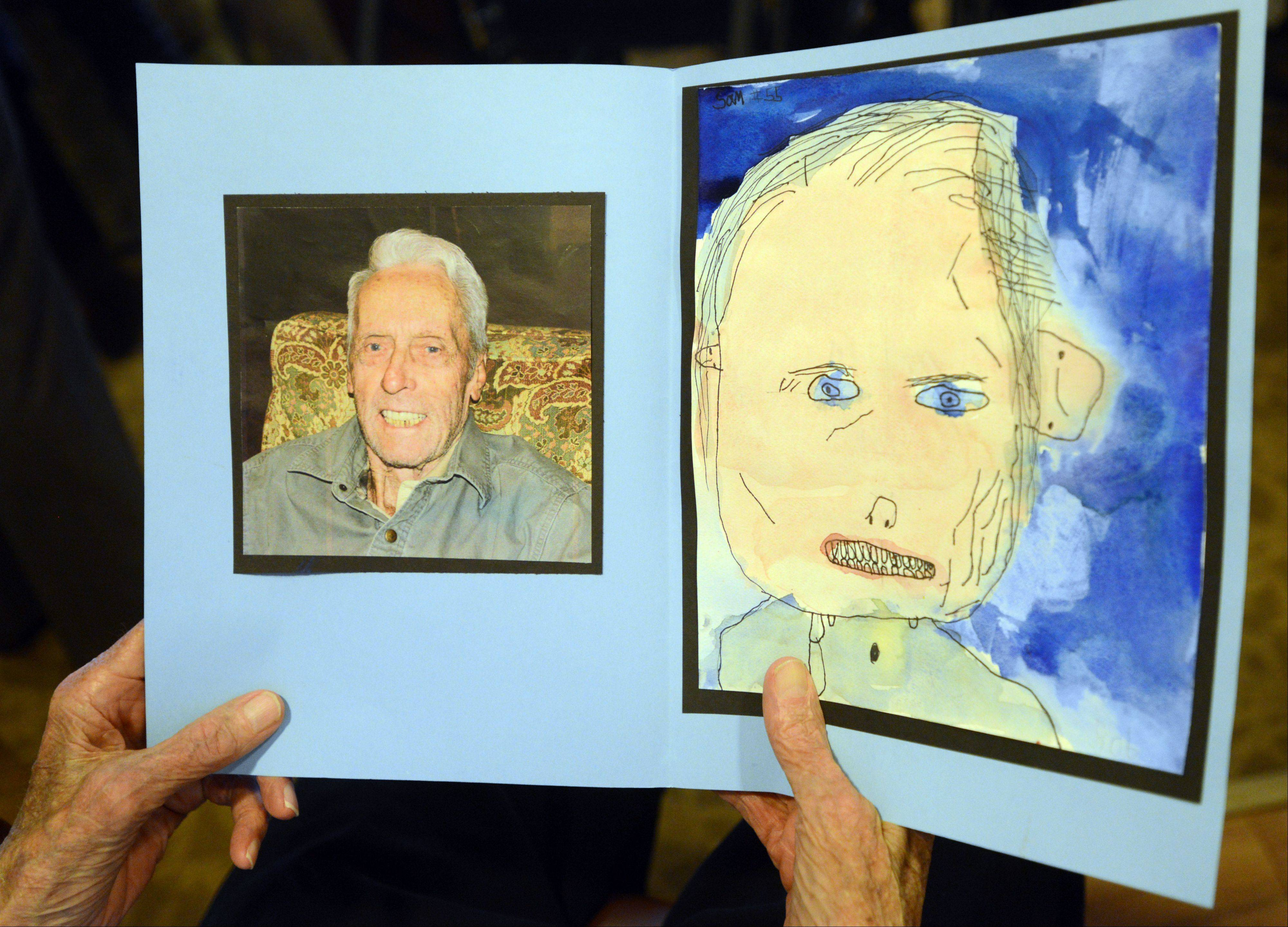 Sunrise Assisted Living resident Bob McCann looks at the portrait given to him by Woodland Elementary West student Sam Cusumano.