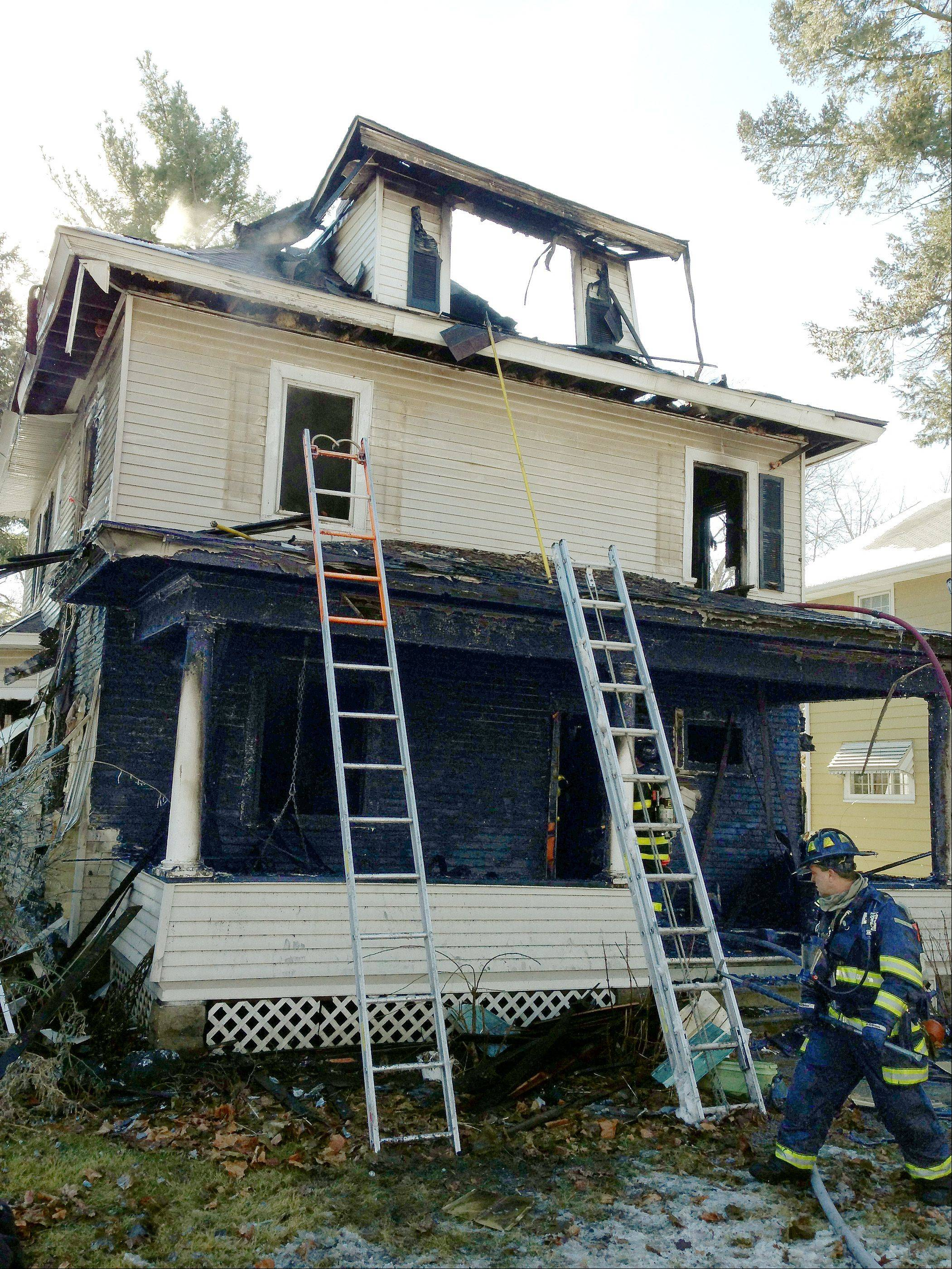 Two people were injured Wednesday in a fire that destroyed this house on the 900 block of Garfield Avenue in Aurora.