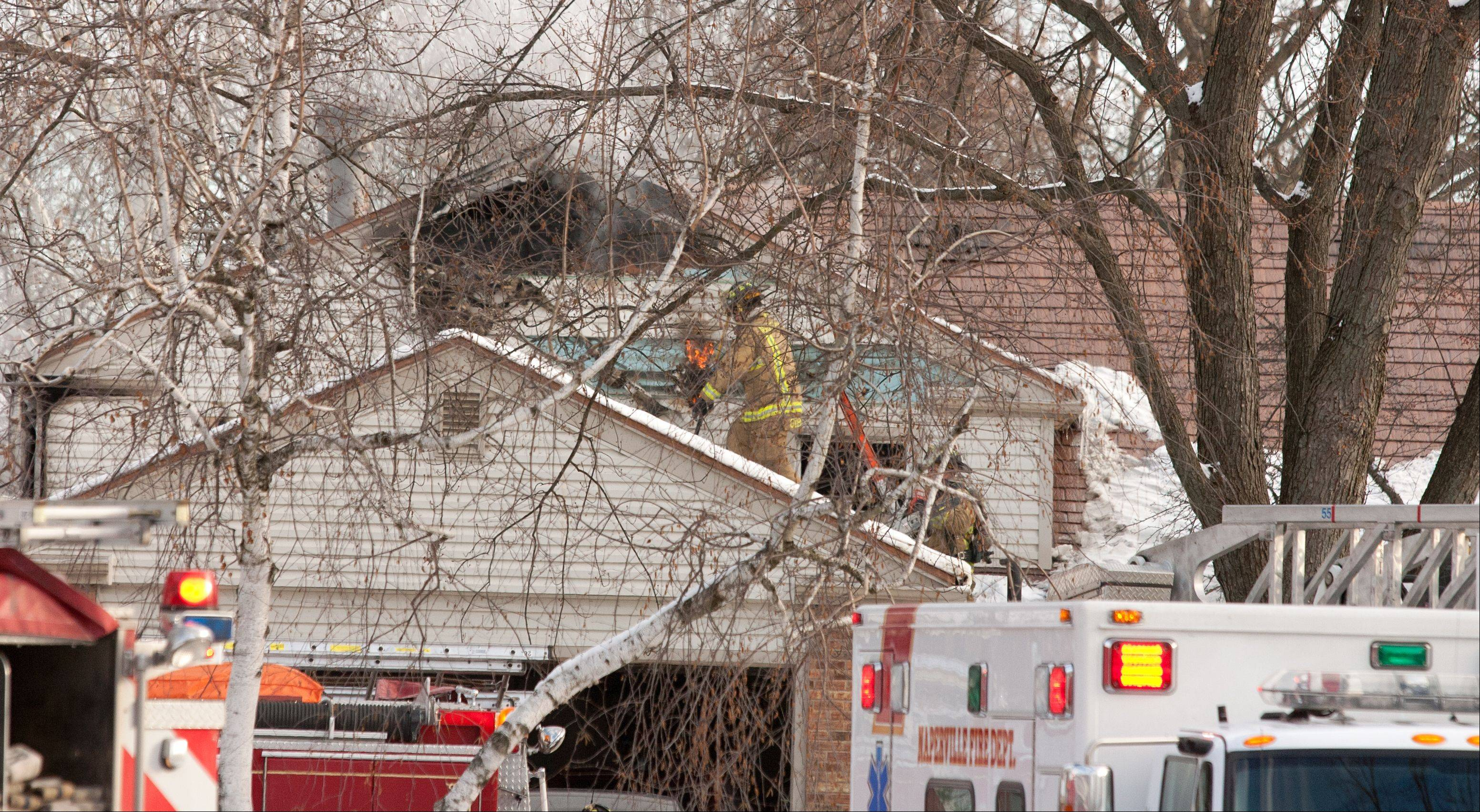 Naperville firefighters are still probing the cause of a house fire that killed two people Wednesday and injured three others.