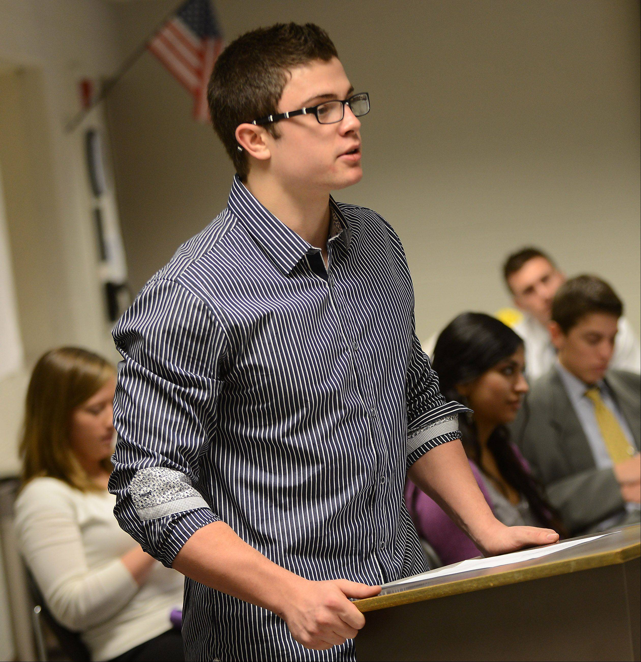 """Defense attorney"" Mitchell Bradberry questions a witness as students at Geneva High School conduct a mock trial Tuesday for a car crash lawsuit that might have involved alcohol."
