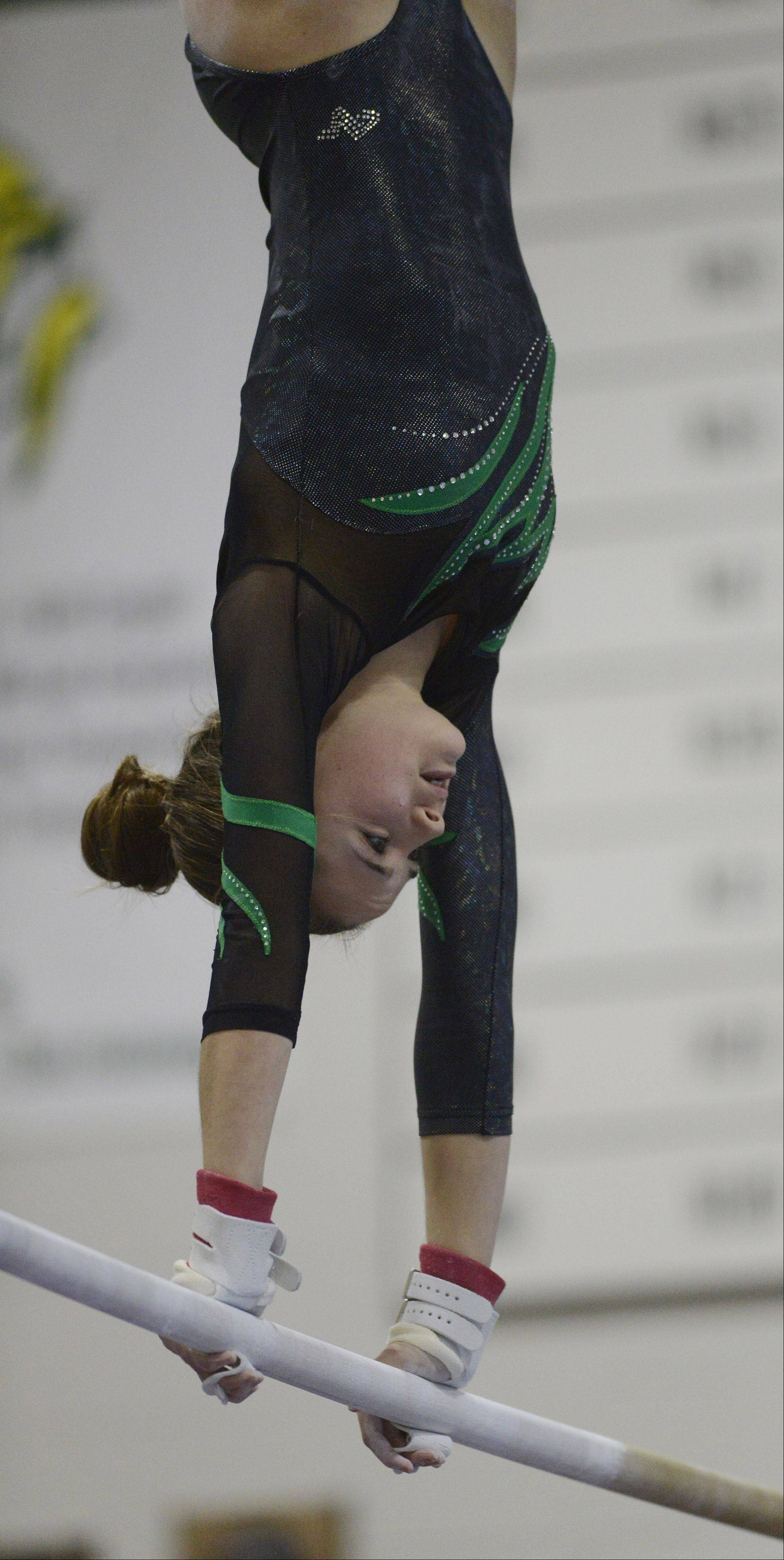 Fremd's Carly DeFilippo competes on the uneven parallel bars during Wednesday's gymnastics meet at Fremd.