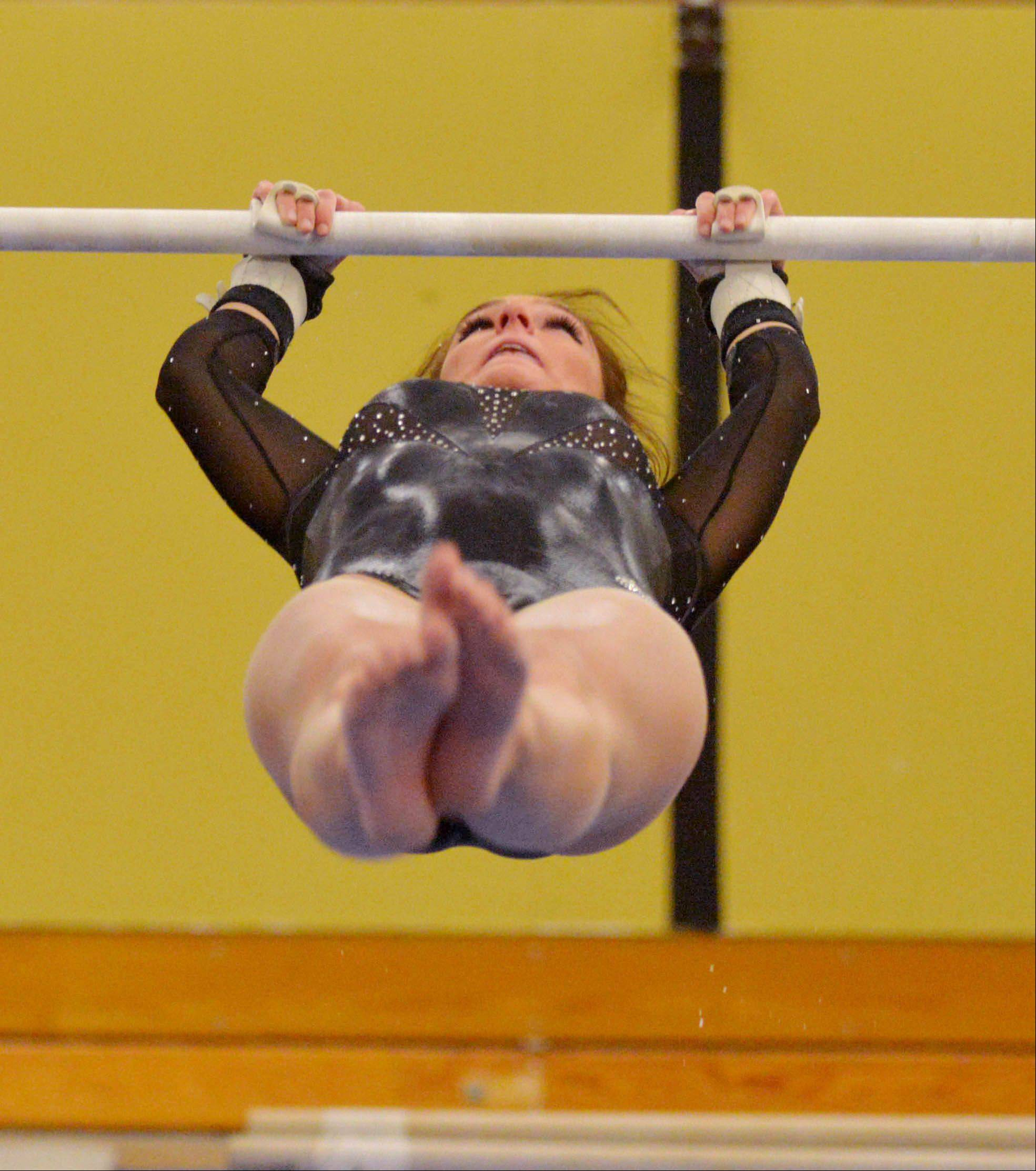 Sierra Thiesse of St. Charles co-op on the bars during the St. Charles co-op at Glenbard North girls gymnastics meet Wednesday.