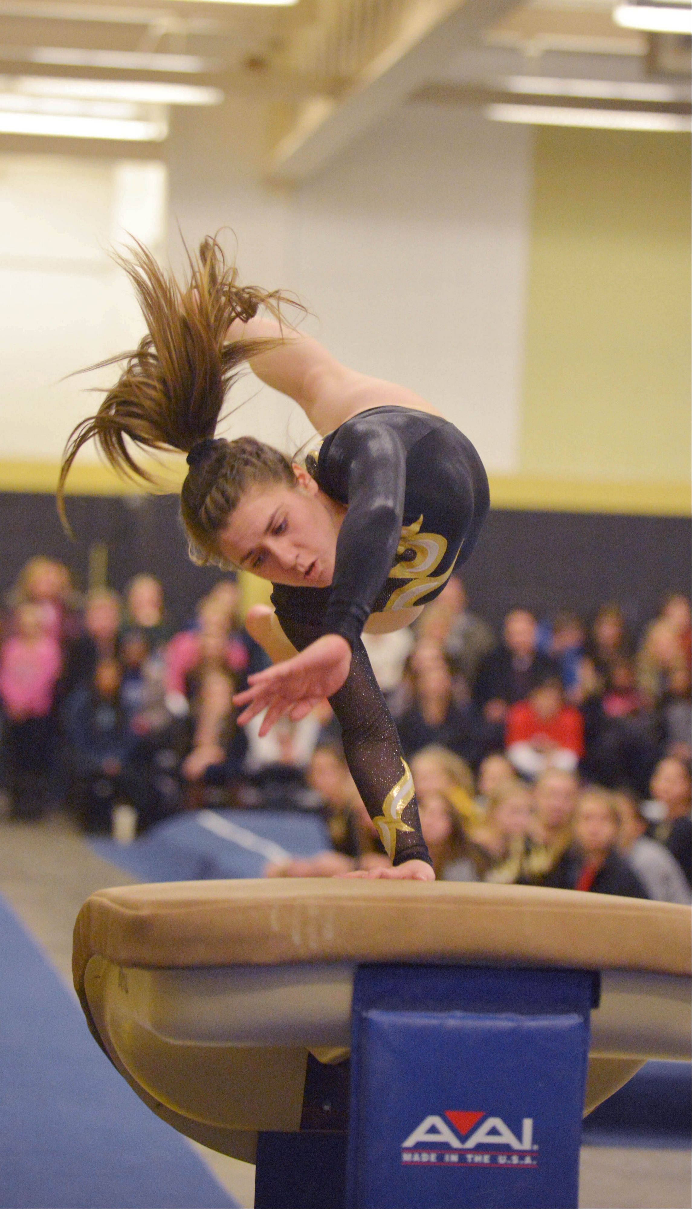Eleni Galanopulos of Glenbard North on the vault during the St. Charles co-op at Glenbard North girls gymnastics meet Wednesday.