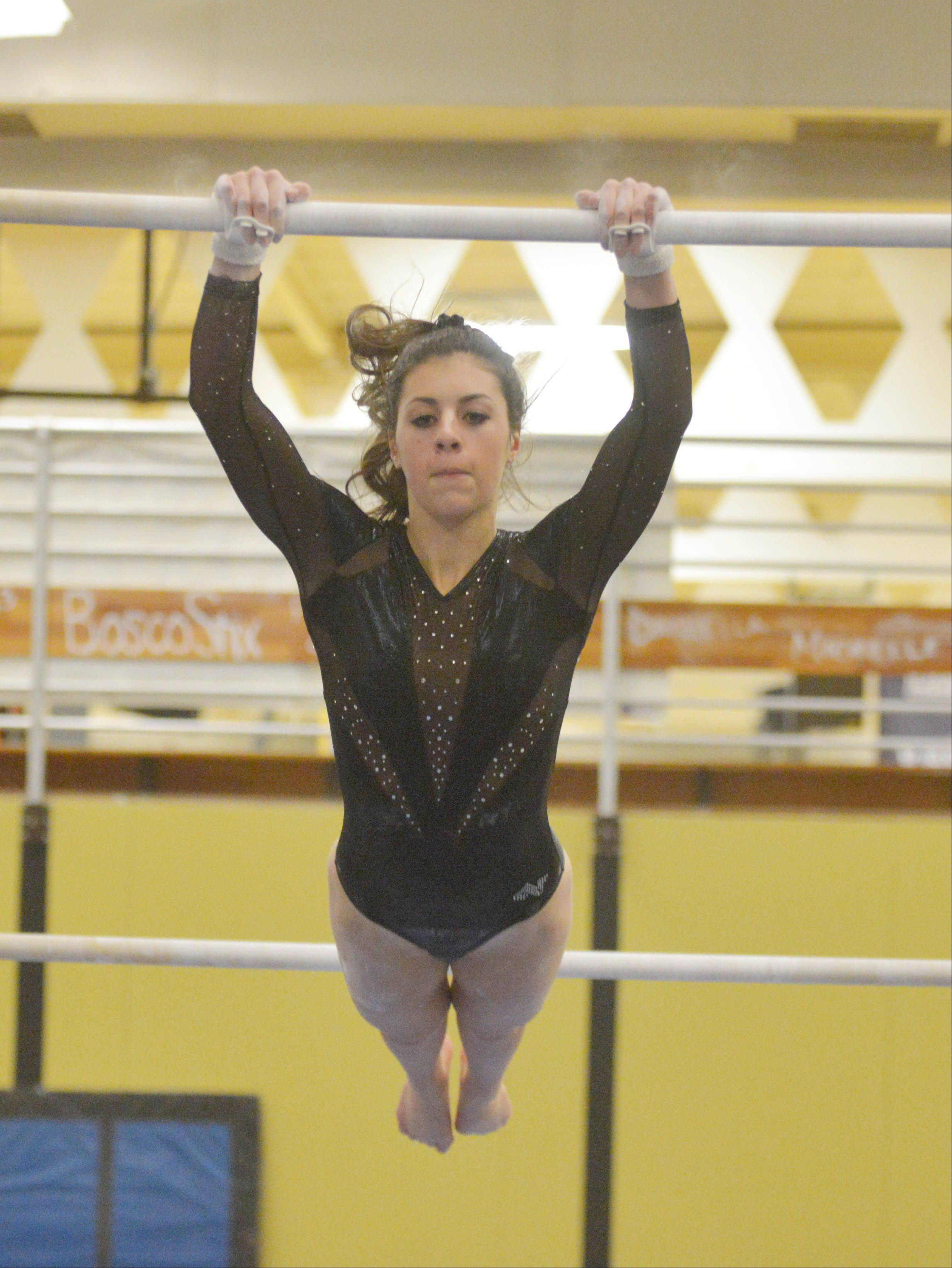 Courtney Buoy of St. Charles co-op on the bars during the St. Charles co-op at Glenbard North girls gymnastics meet Wednesday.