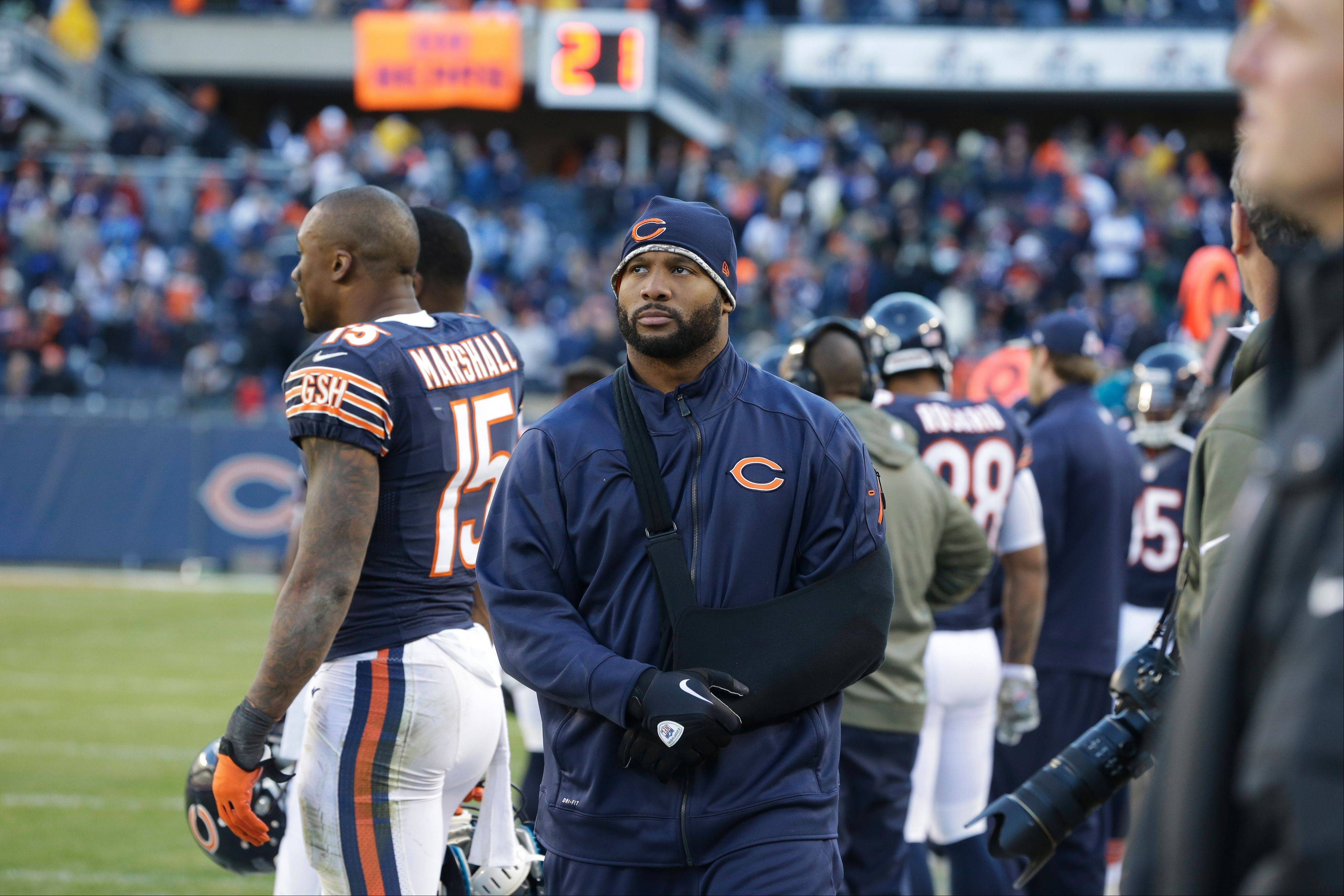 Lance Briggs, walking the sideline during the Bears' loss to the Lions on Nov. 10, might be able to return Sunday in Philadelphia.