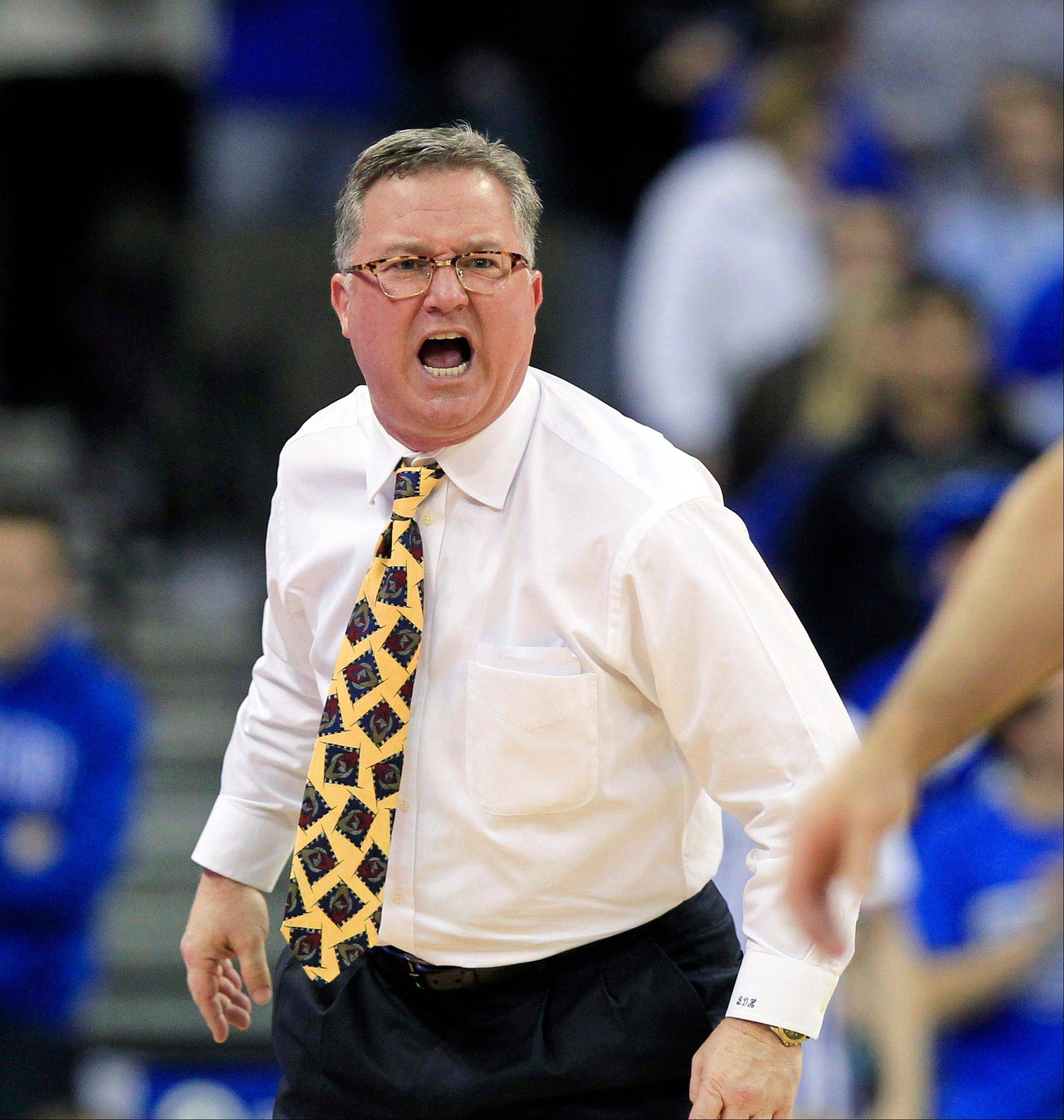 "In this Feb. 19, 2013 file photo, Southern Illinois head coach Barry Hinson yells during the second half og an NCAA college basketball game against Creighton, in Omaha, Neb. Hinson lambasted his players after a loss at Murray State, calling them ""uncoachable,"" a ""bunch of mama's boys"" and comparing disciplining his young team to housebreaking a puppy. Hinson was not made available for comment Wednesday morning."