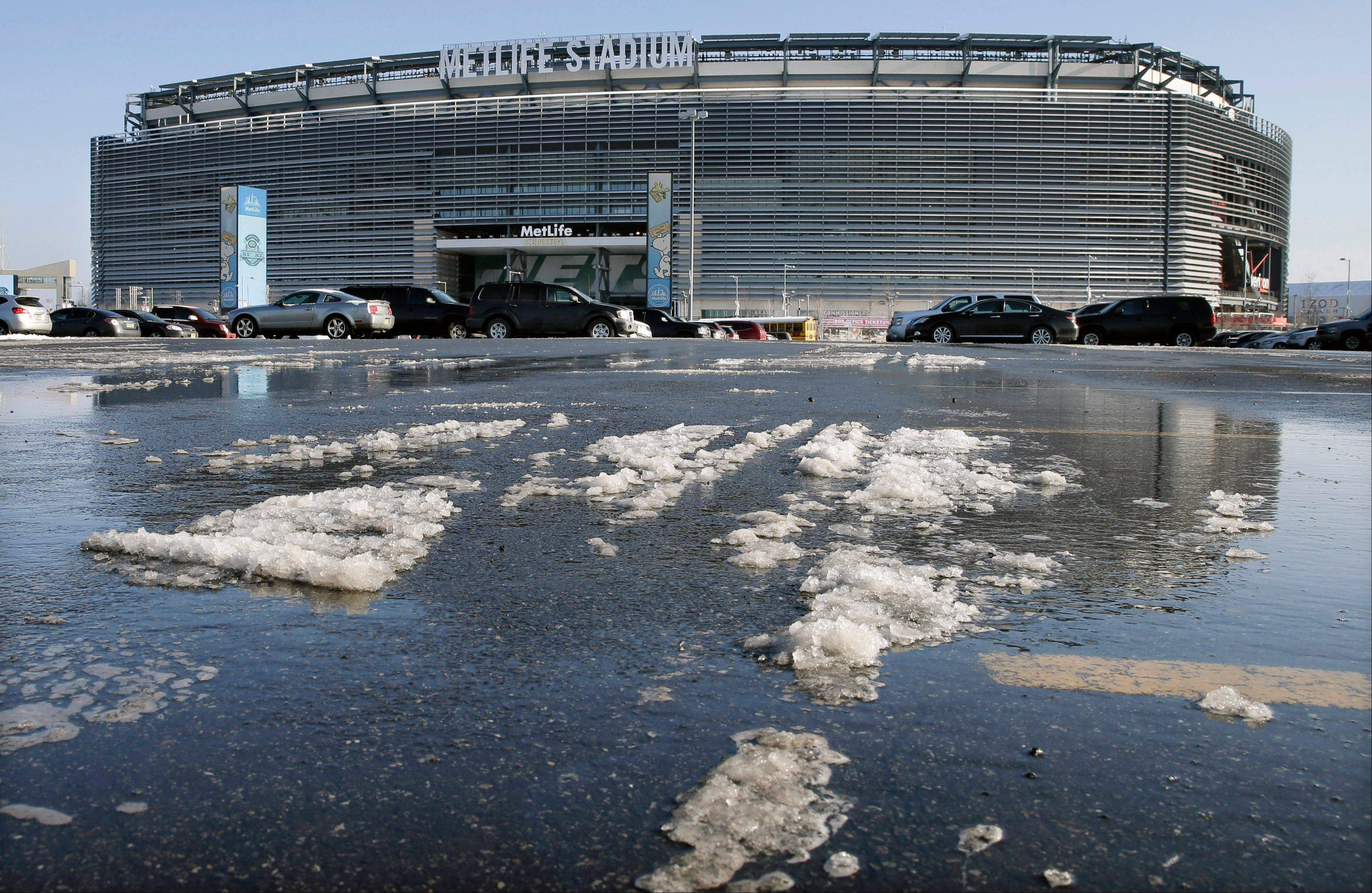 Snow and slush left from Tuesday's snowfall is seen outside MetLife stadium in East Rutherford, N.J. Later Wednesday, at MetLife, officials demonstrated snow removal and melting machinery and outlined emergency weather scenarios and contingency plans for the Super Bowl in February.