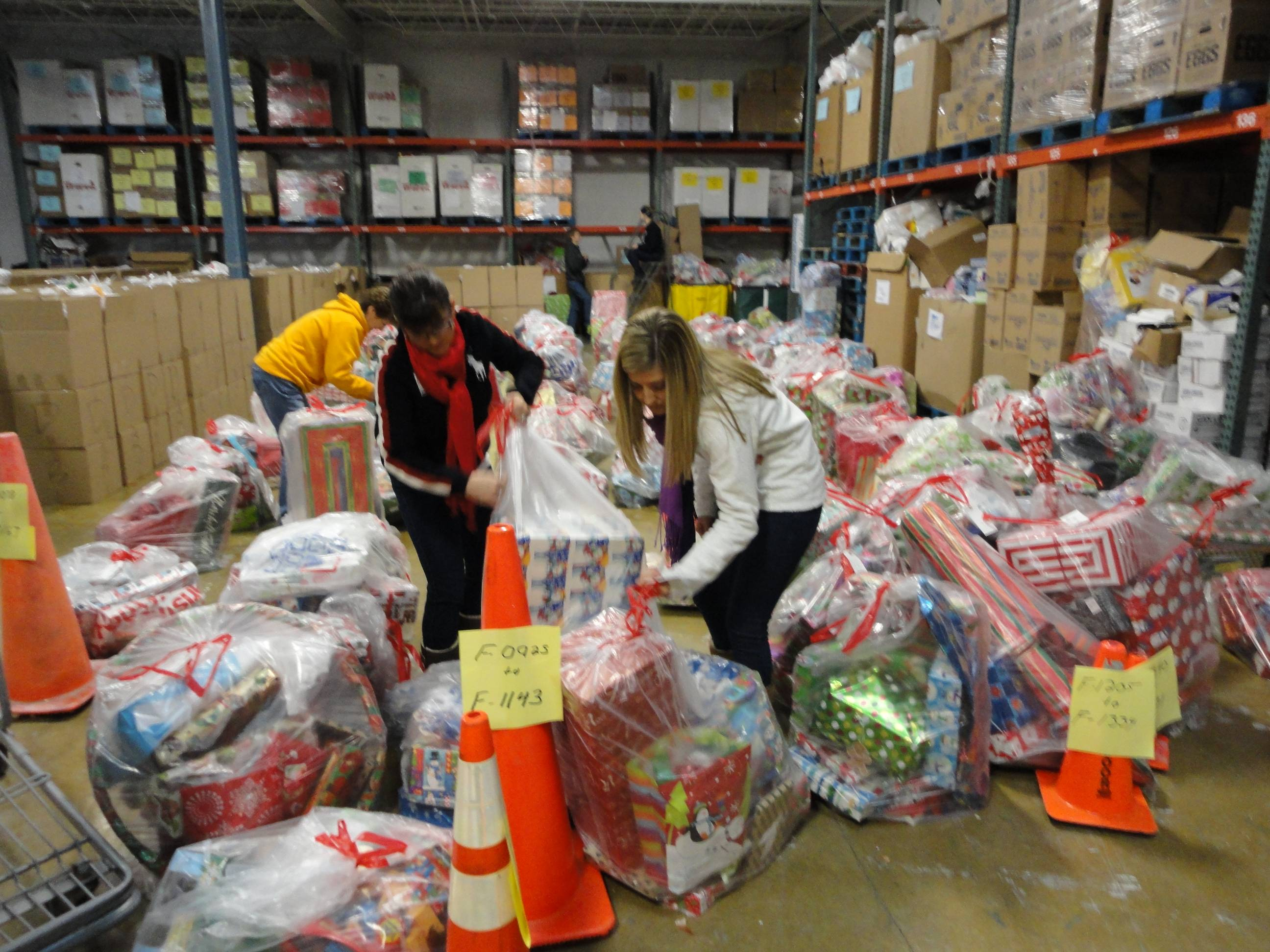 HSP volunteers preparing gifts to be distributed to needy children.