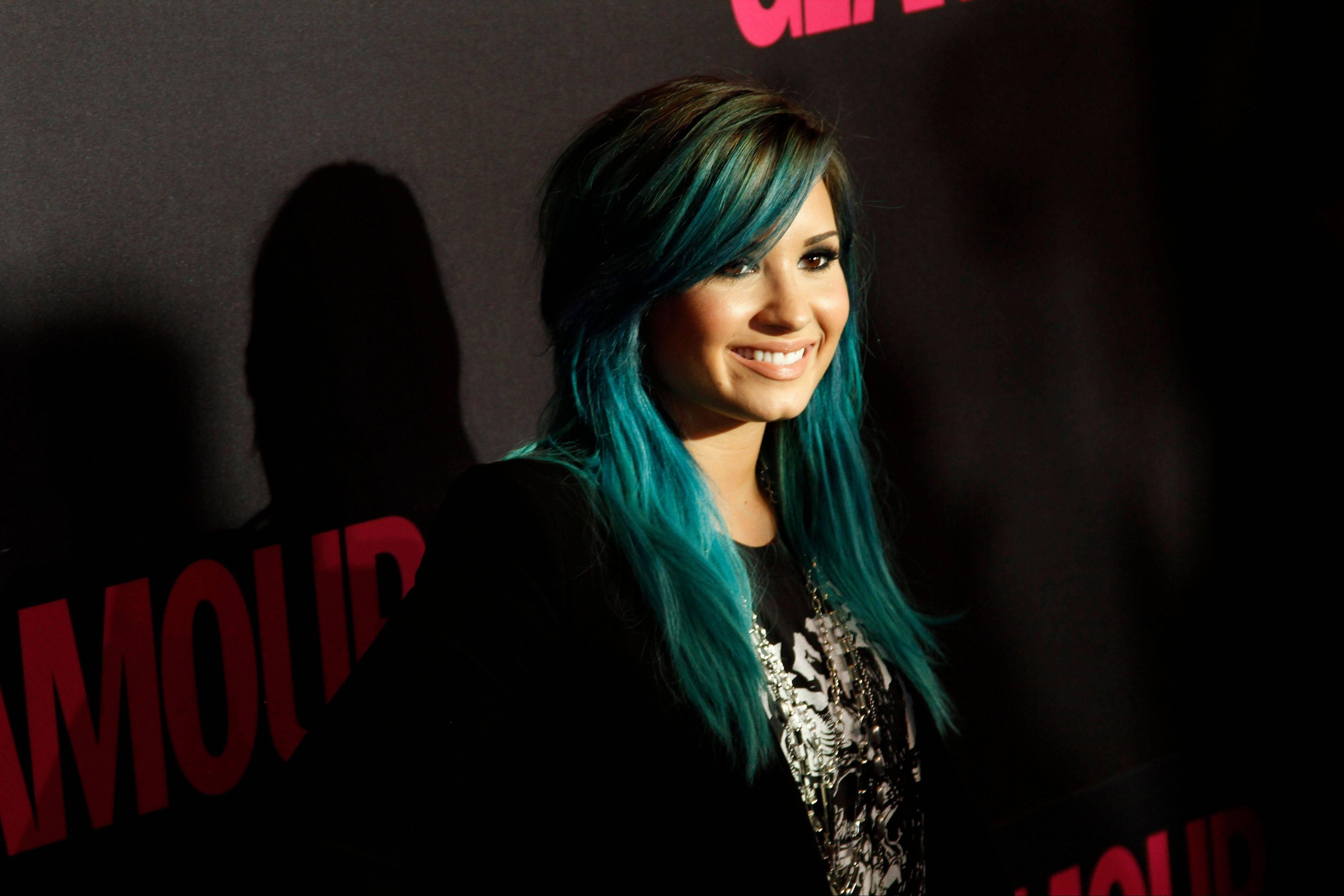 Demi Lovato said Wednesday that she is leaving �The X Factor� to focus on her music.