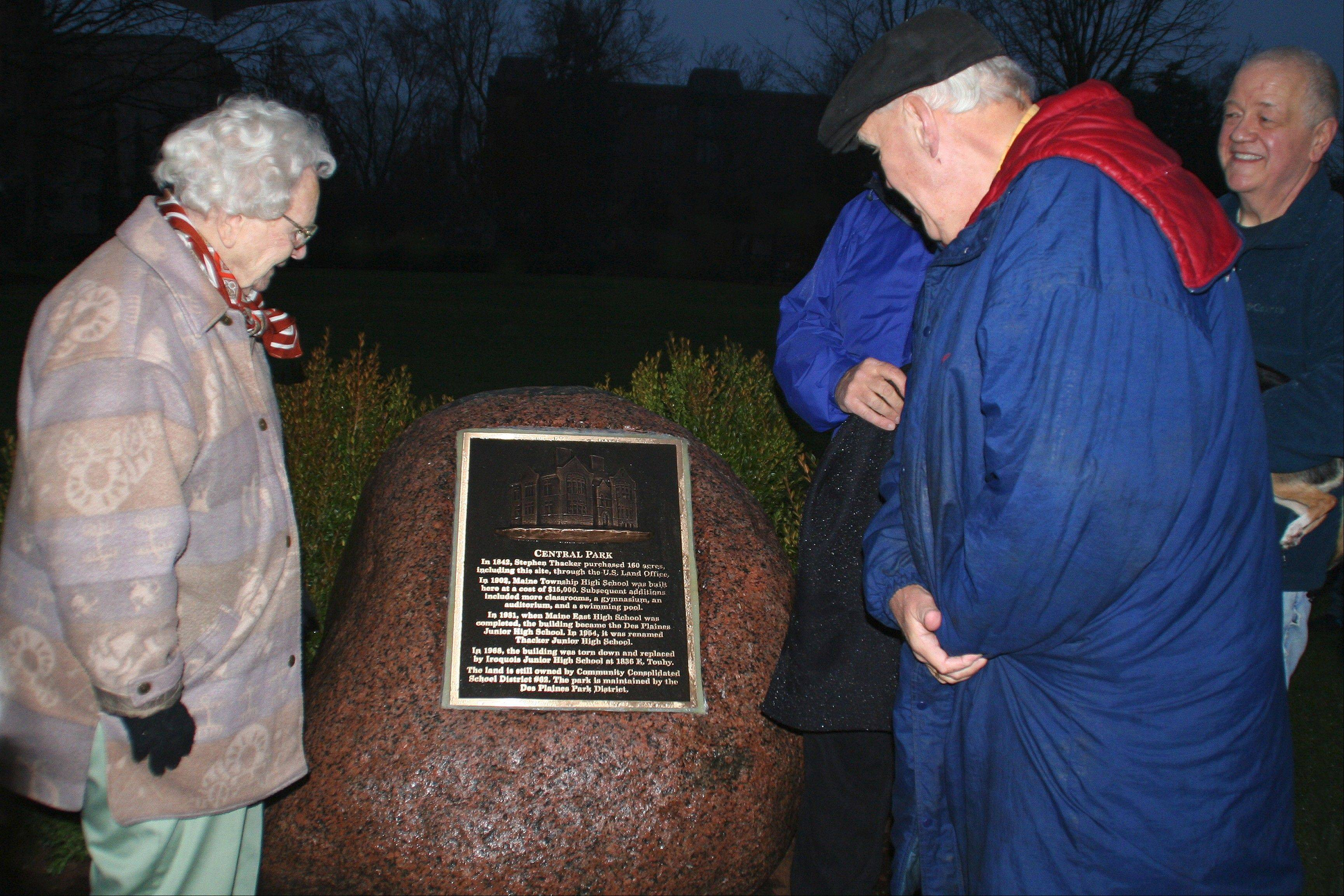 Marion Lutz, Des Plaines Junior High School graduating class of 1932, unveils the new historic marker in Central Park.