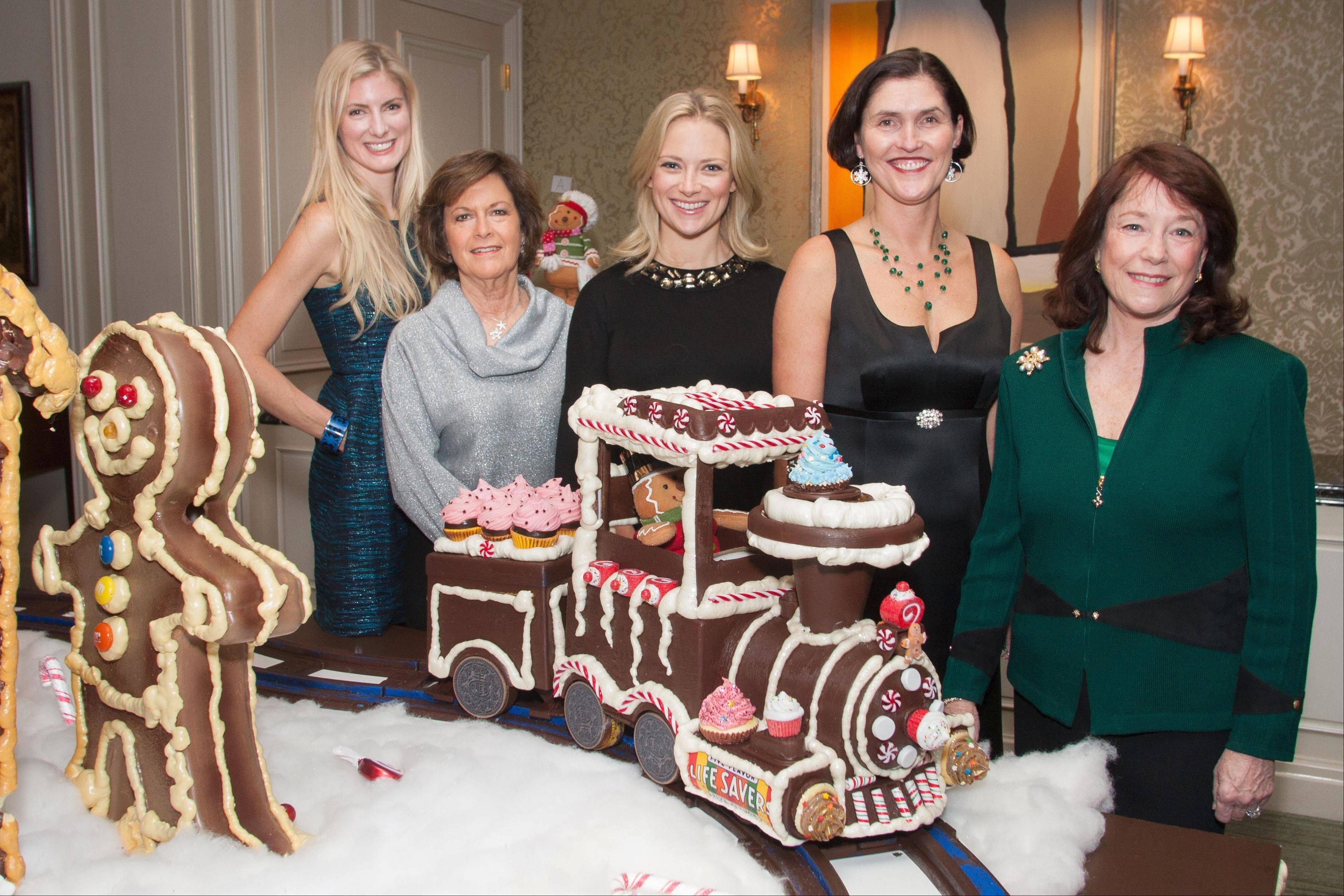 Event Co-chairwoman Meghan Norton, WINGS board Chairman Rita Canning, event Co-chairwoman Anna Bilton, WINGS Chief Executive Officer Rebecca Darr and honorary Co-chairman Jackie Tilton at the WINGS �Sweet Home Chicago� gala.