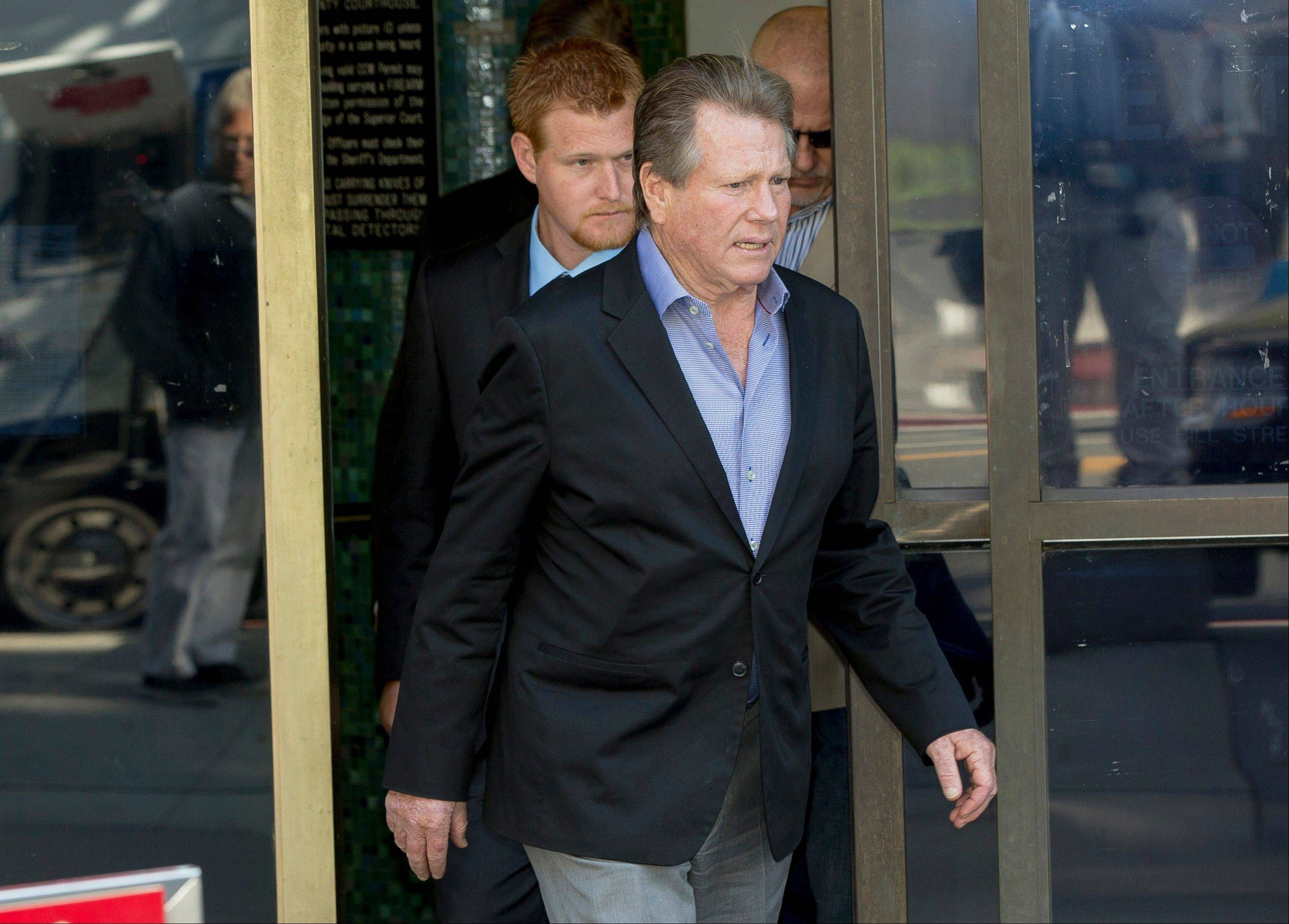 Ryan O'Neal, center, followed by his son, Redmond O'Neal, as they exit court for a lunch break in Los Angeles.