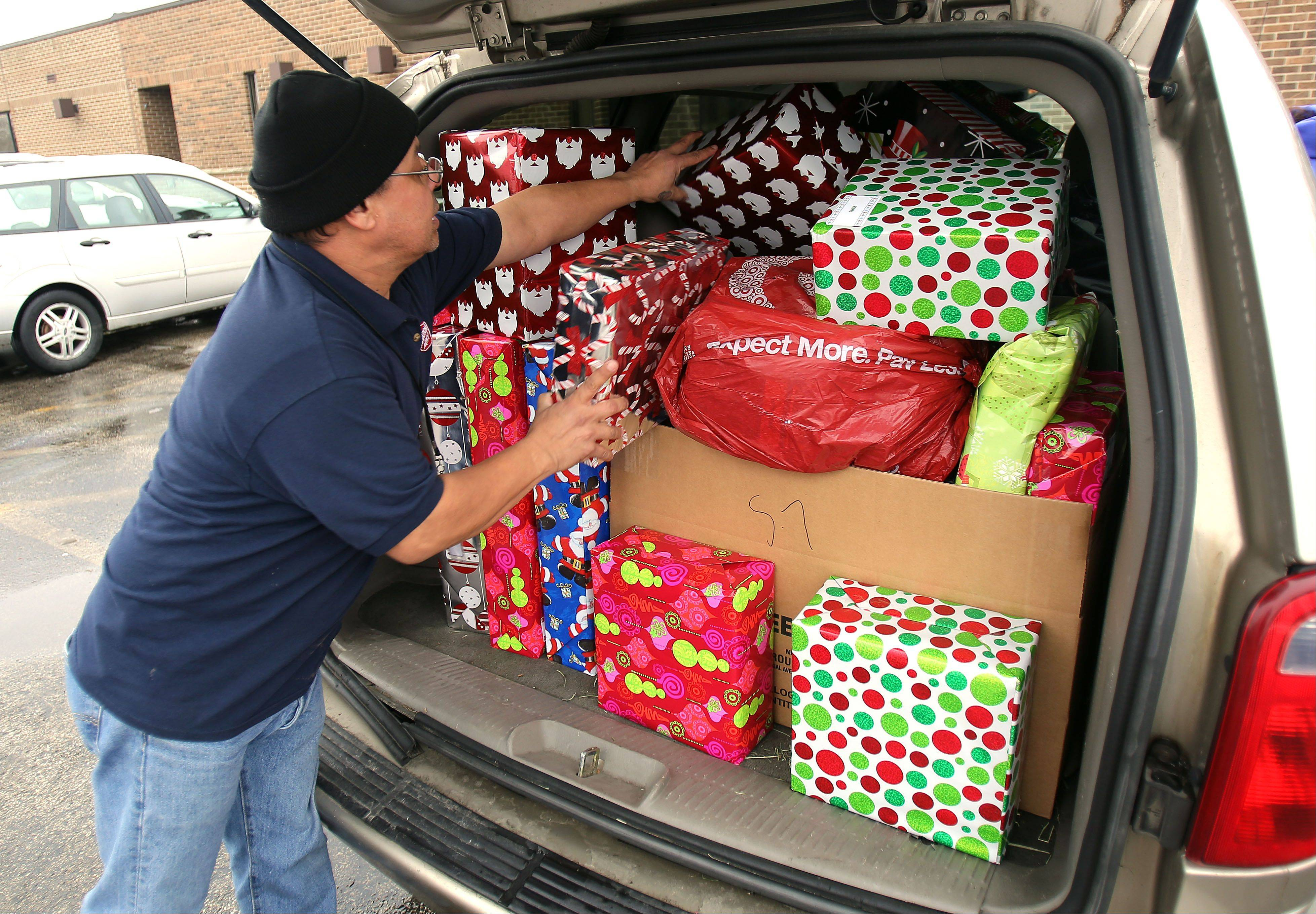 Salvation Army worker Stewart Porto loads a mini van with Christmas presents Thursday at the Salvation Army Waukegan Corps Community Center. The Angel Tree program provides gifts to more than 225 registered families, including 500 children.