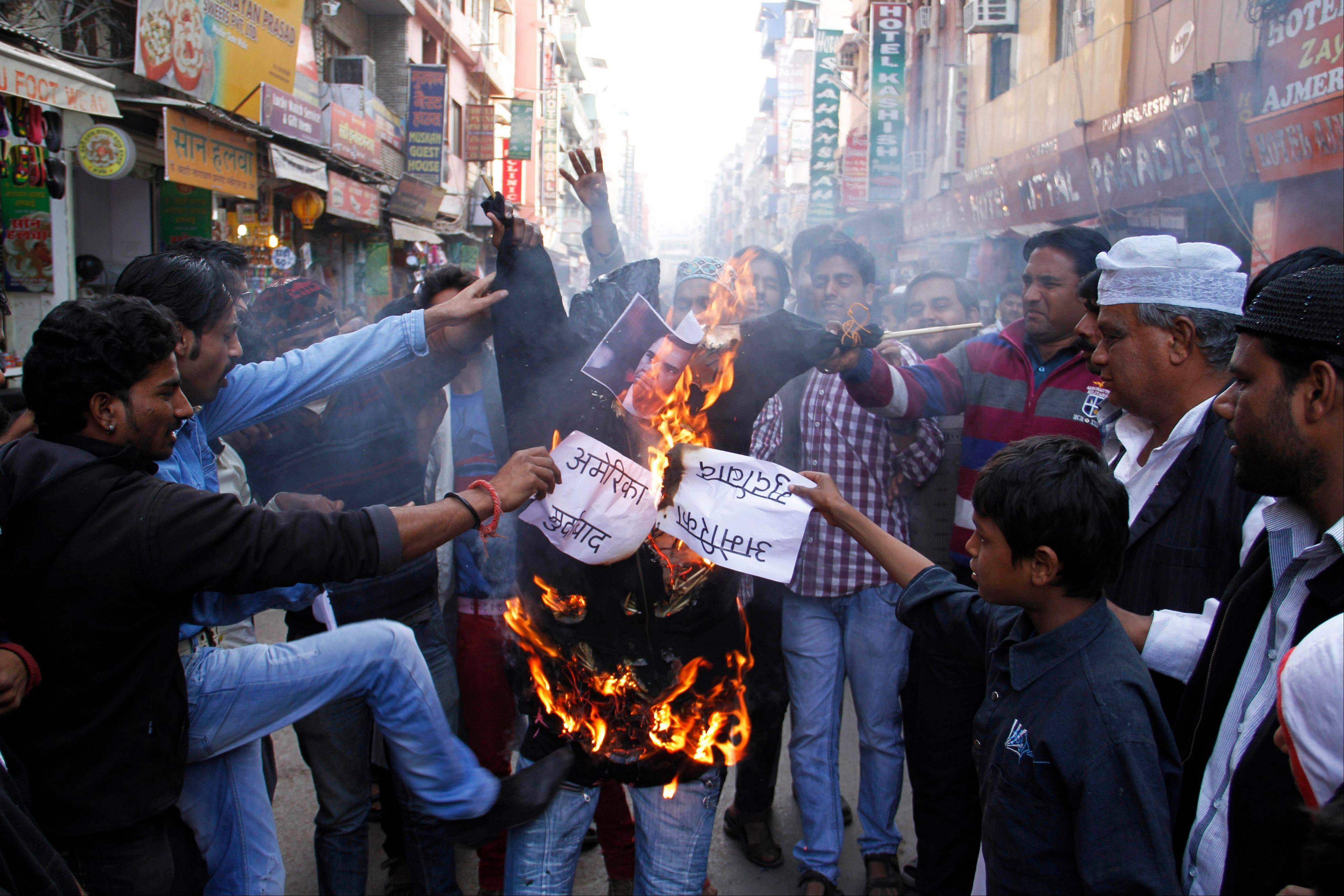 Indian Muslims burn an effigy of President Barack Obama as they protest against the alleged mistreatment of New York based Indian diplomat Devyani Khobragade, in Ajmer, India, Thursday. The case has sparked a diplomatic furor between the United States and India, which is incensed over what its officials described as degrading treatment towards India�s deputy consul general in New York.