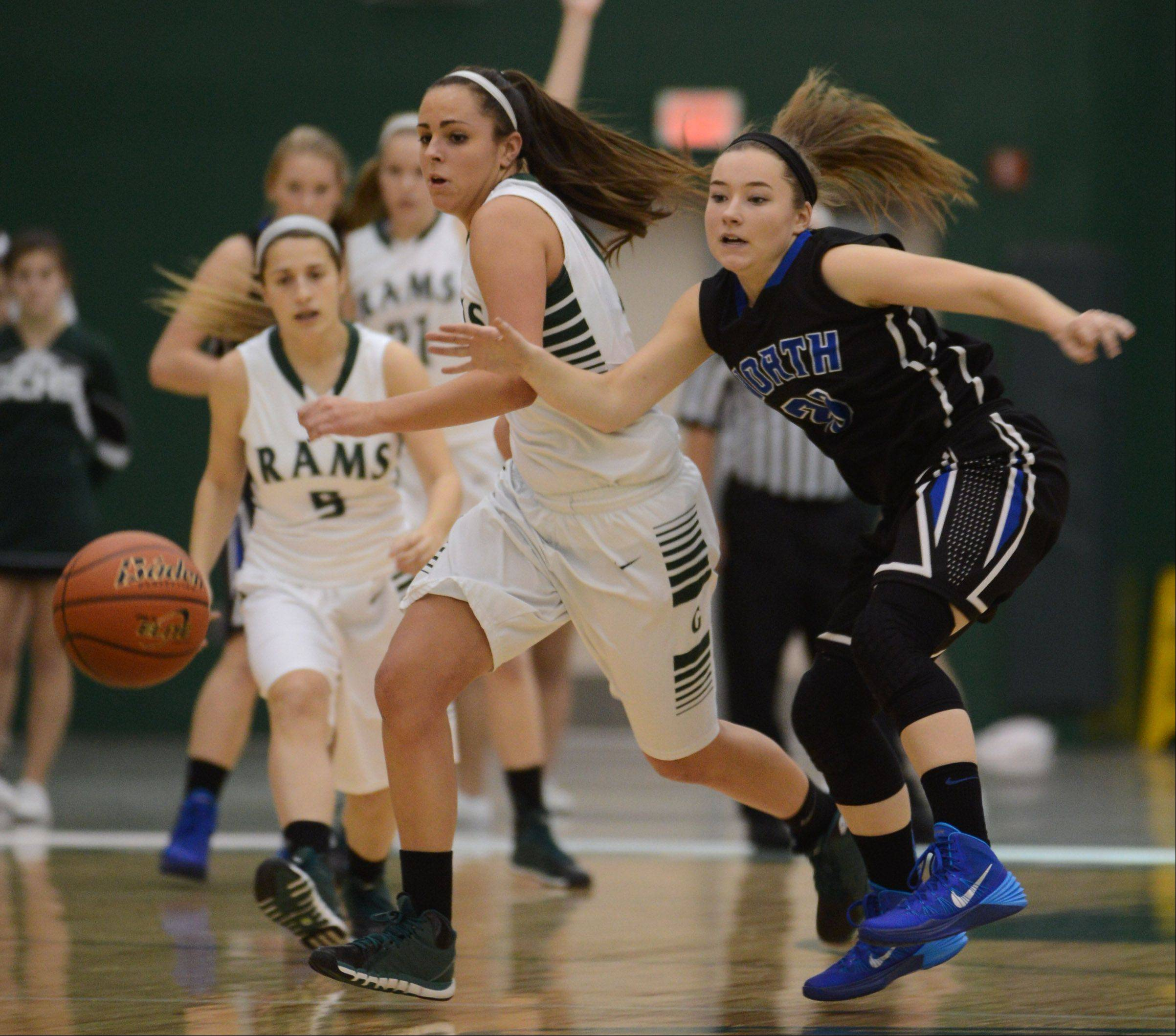 Grayslake Central�s Carson Sparkman, left, and St. Charles North�s Sam Novak chase down a loose ball during Thursday�s game in Grayslake.