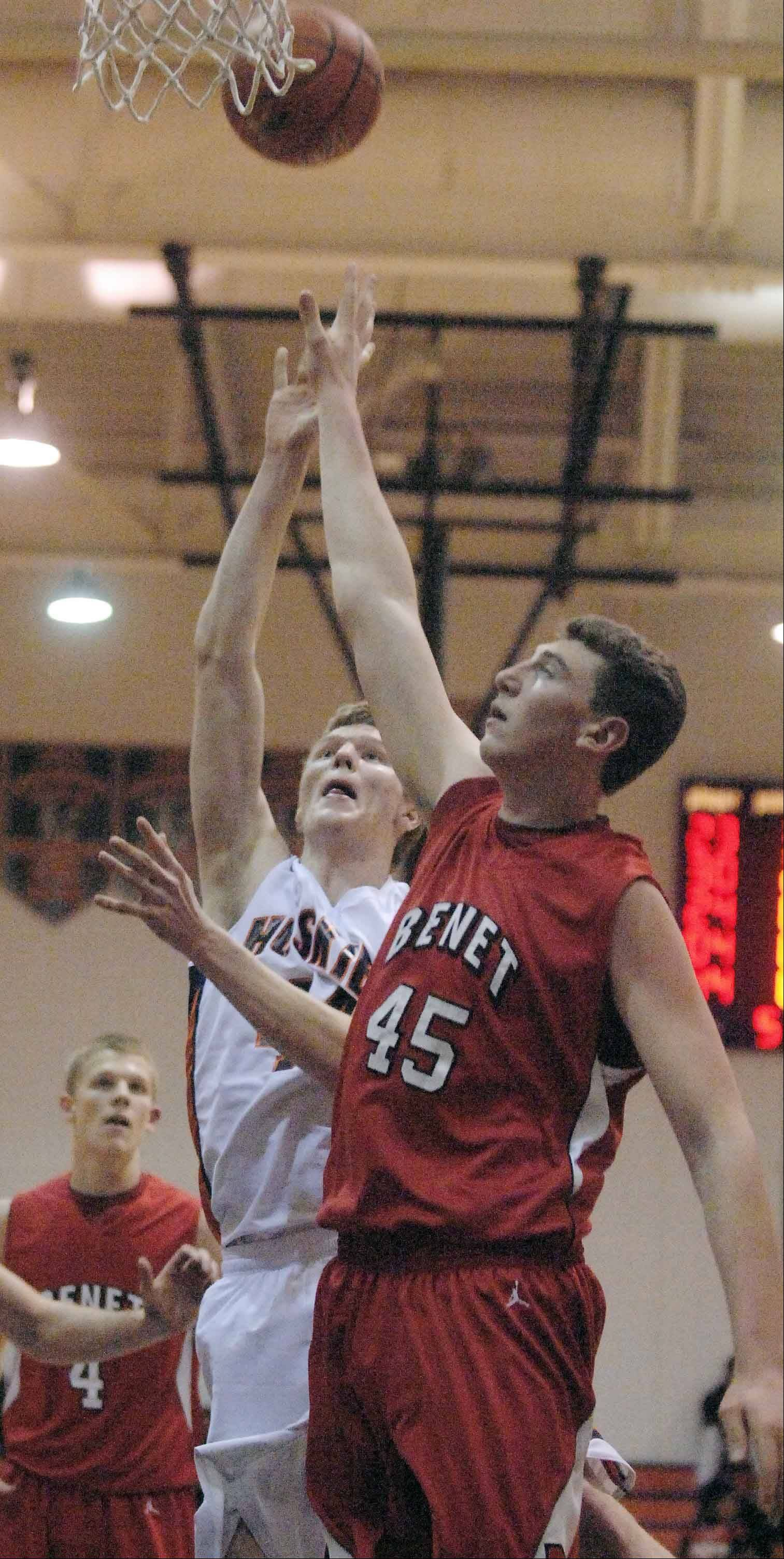 Mike Johnson of Naperville North,left, and Sean O�Mara of Benet go up for a rebound. This took place during the Benet at Naperville North boys basketball game Tuesday.