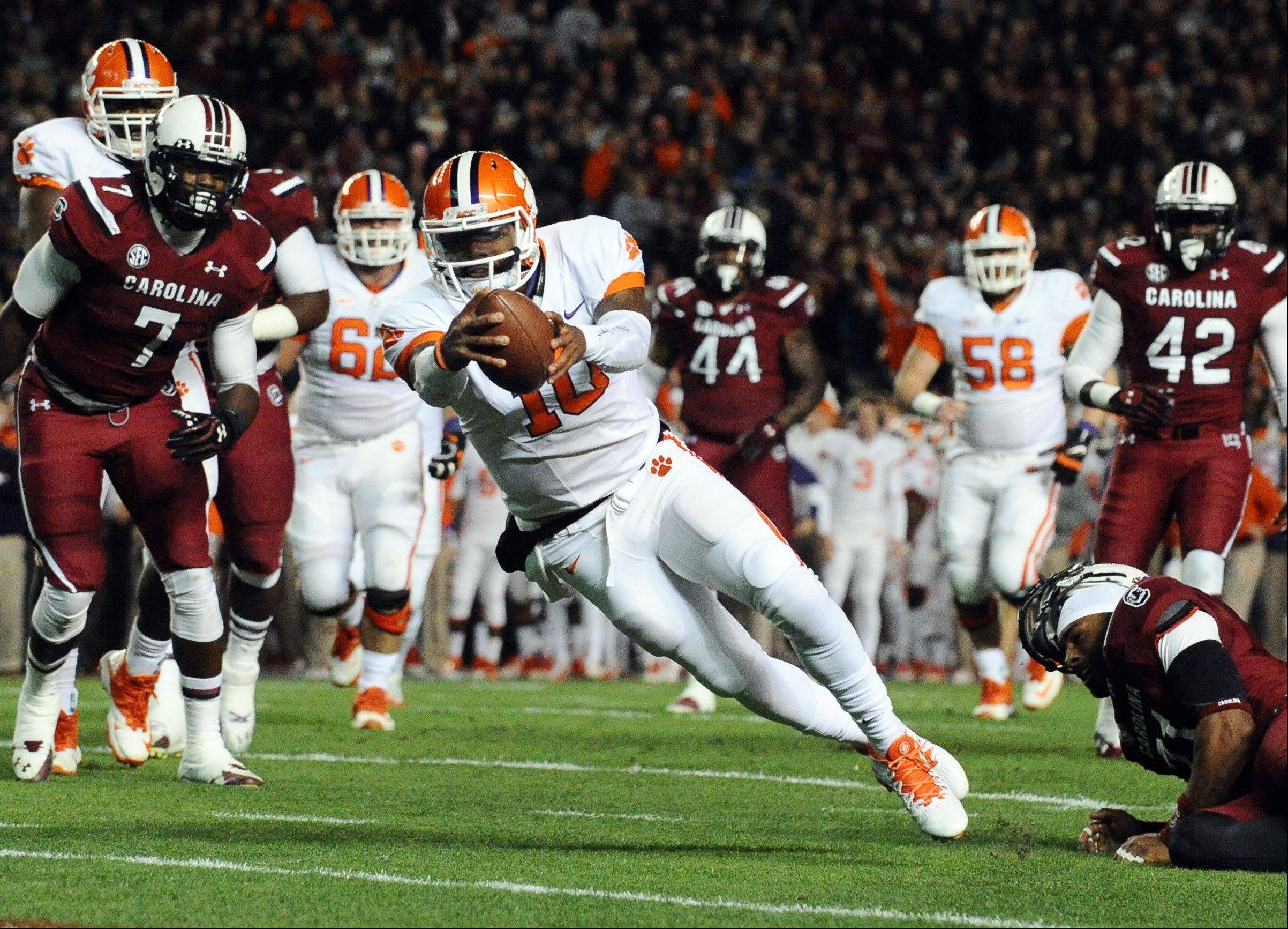 Clemson quarterback Tajh Boyd dives into the end zone for a touchdown during the first half of the Nov. 30 game against South Carolina in Columbia, S.C. Boyd is tied for 15th in major-college history with 102 touchdown passes.