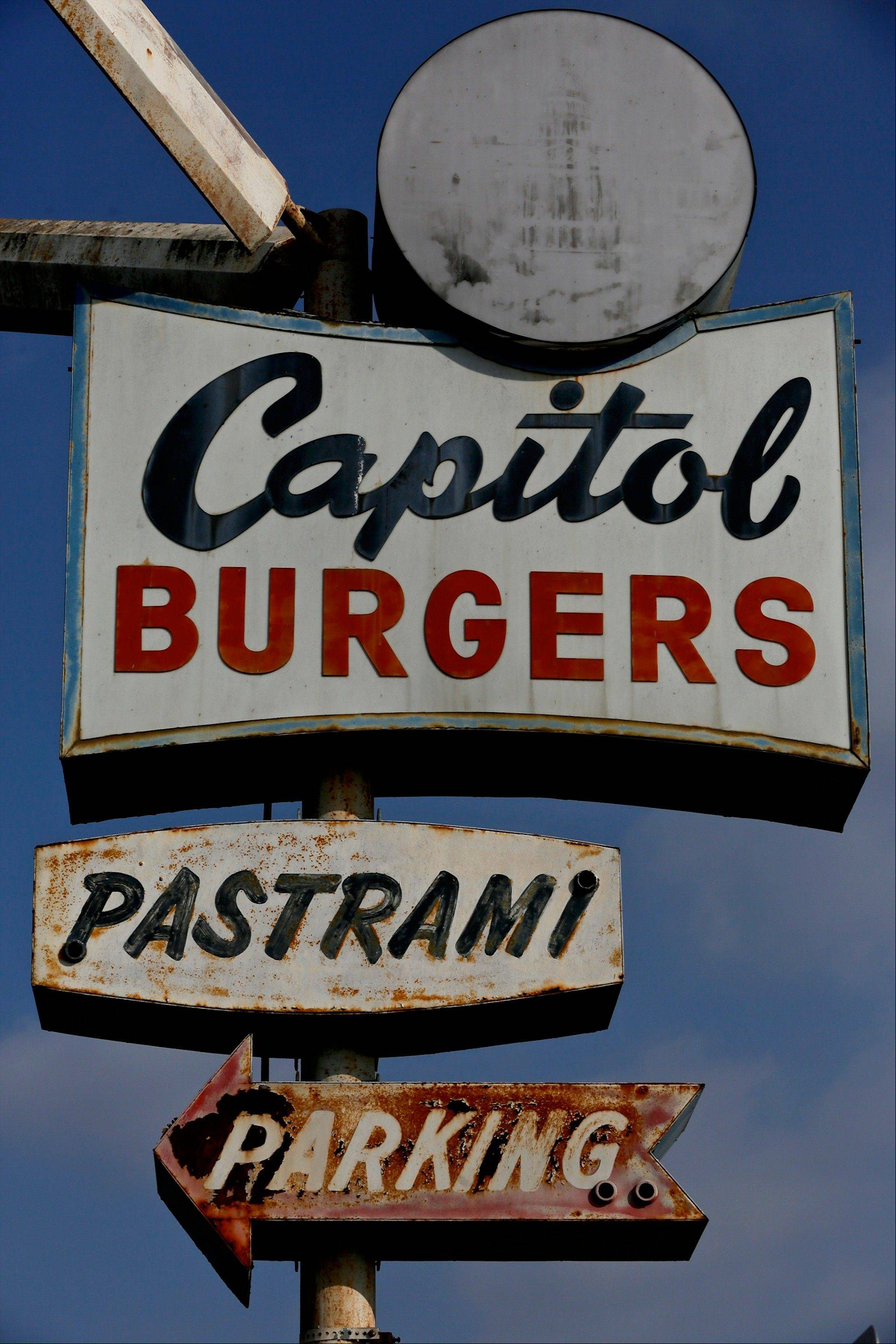 Capitol Burgers, an old-school hamburger stand in a not-so-glitzy part of town, has been dishing out unadulterated burgers and fries since 1965. Capitol owner George Stamos was crafting burgers for folks their way, right away. Stamos died earlier this year, but his family has kept the griddle fired up in honor of their patriarch who originally immigrated to the United States from Greece.