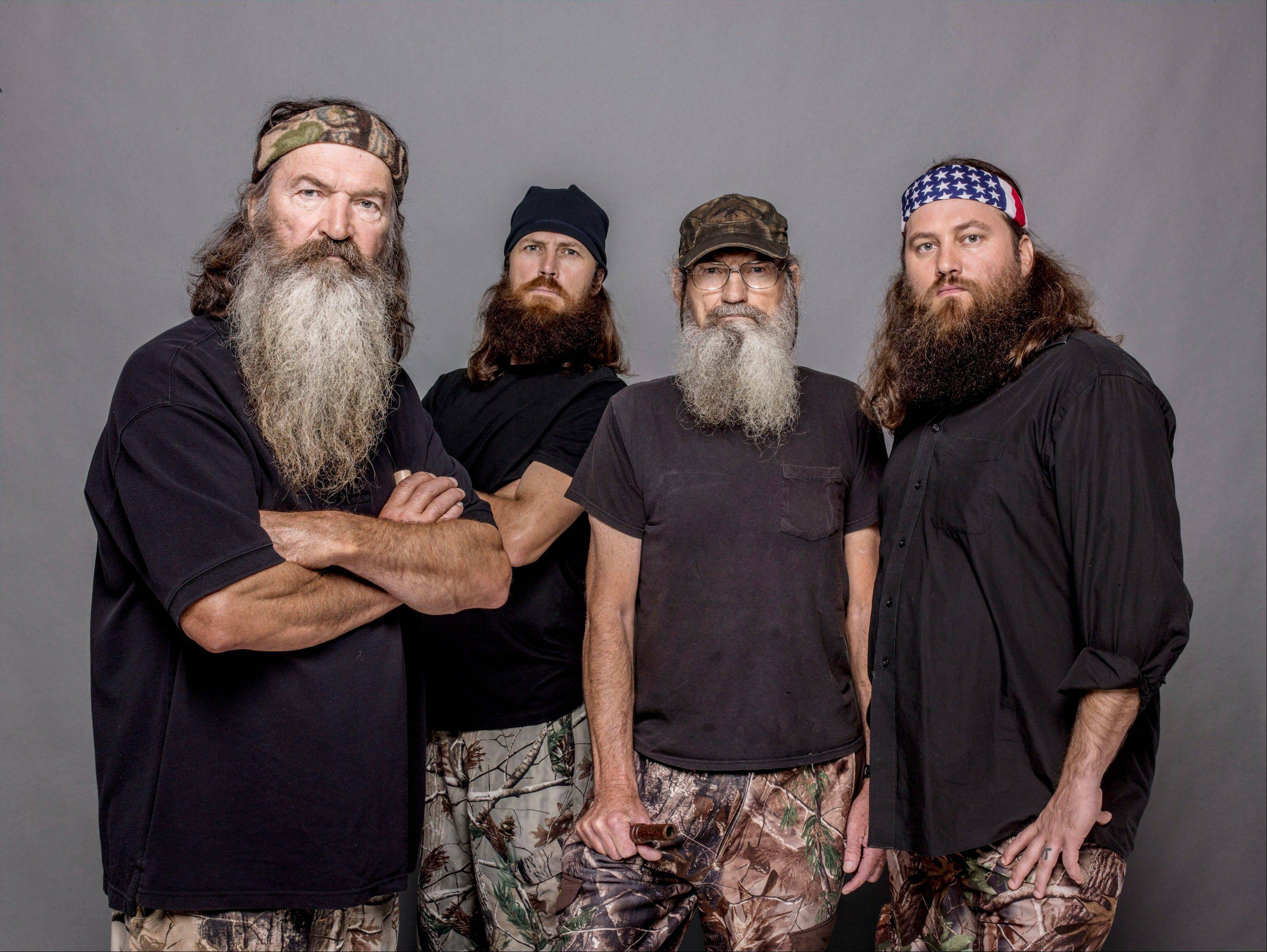 "The A&E channel says ""Duck Dynasty"" patriarch Phil Robertson, left, (who stars with Jase Robertson, Si Robertson and Willie Robertson) is off the show indefinitely after condemning gays as sinners in a magazine interview."