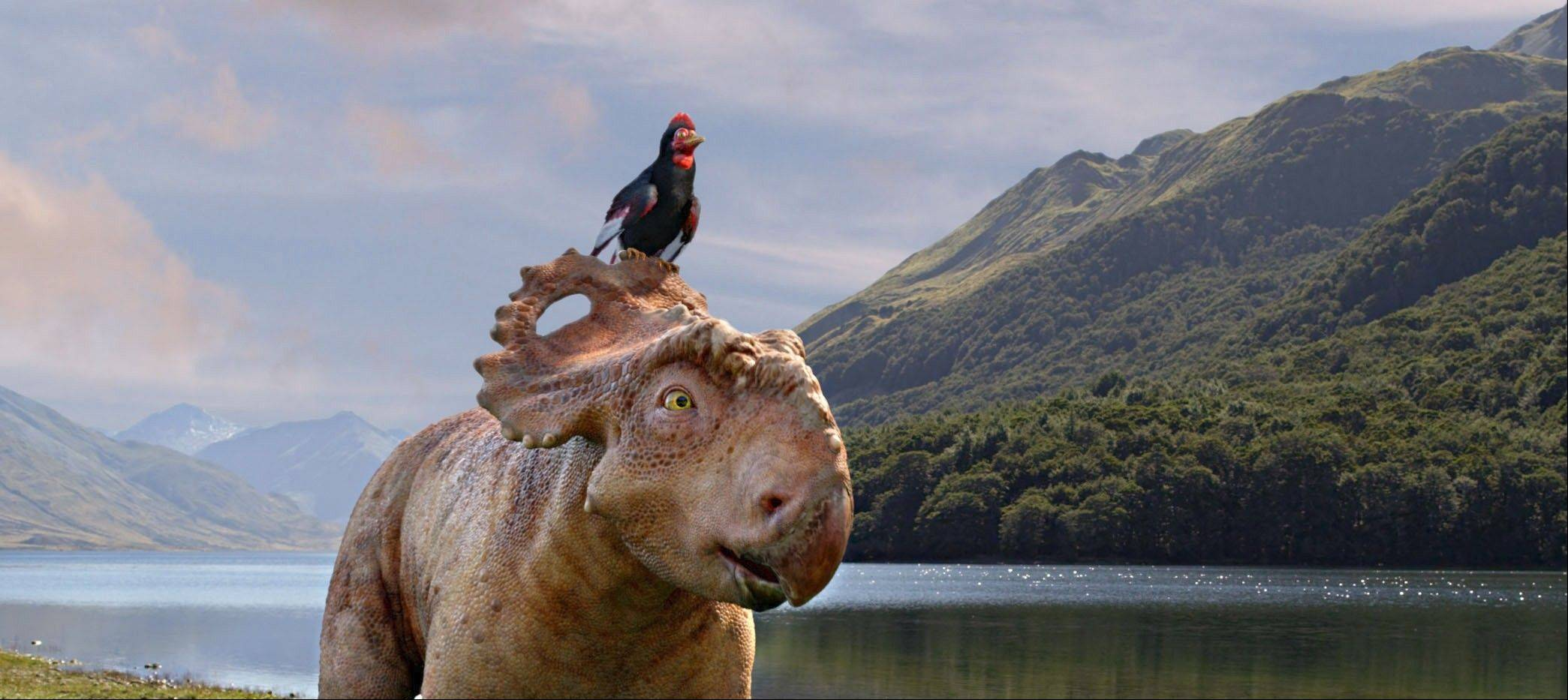 "Patchi (voiced by Justin Long) and his friend Alex the prehistoric bird (voiced by John Leguizamo) hang together in ""Walking With Dinosaurs."""