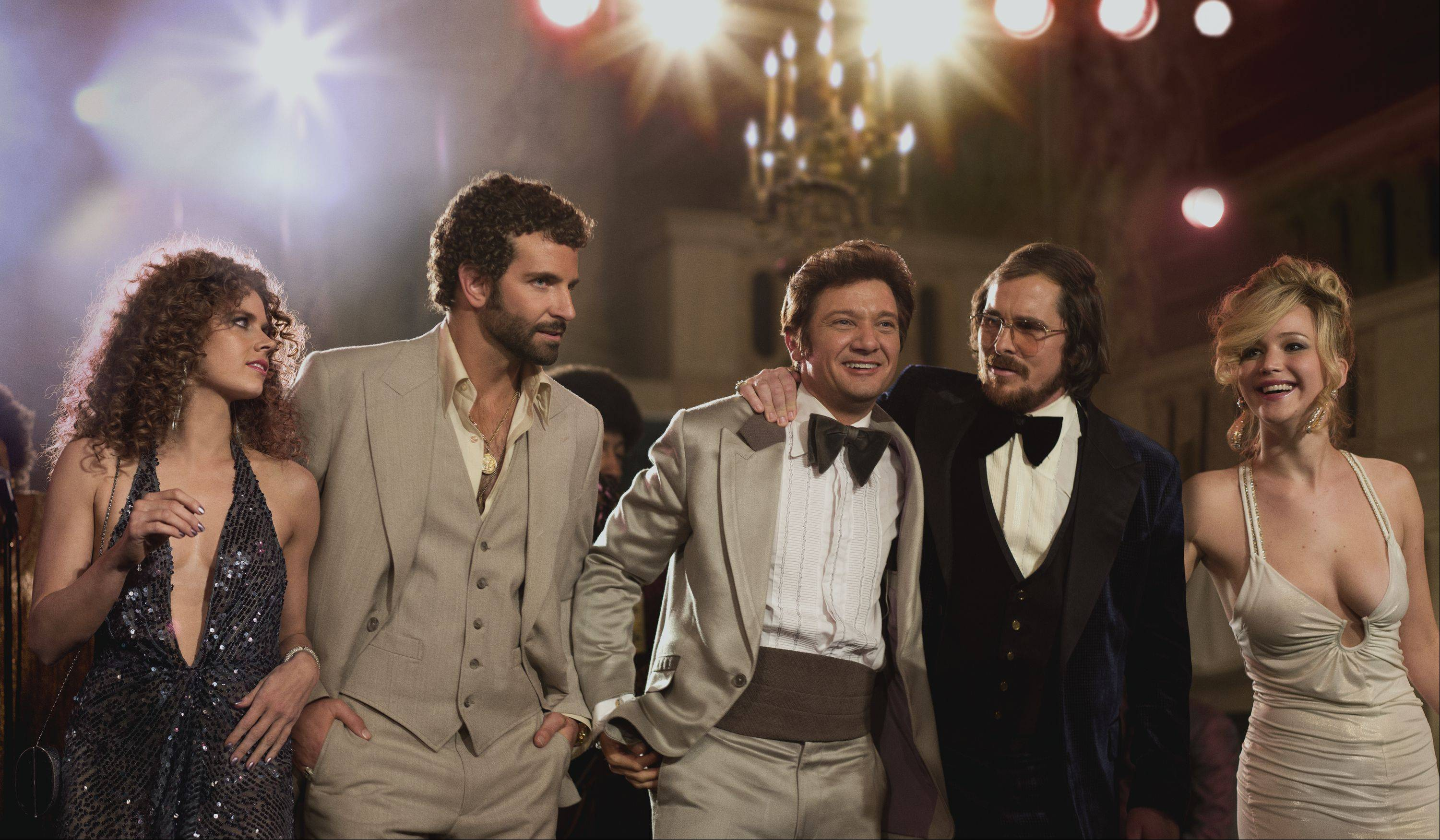 "Amy Adams, Bradley Cooper, Jeremy Renner, Christian Bale and Jennifer Lawrence party hard as characters caught up in the Abscam scandal in David O. Russell's ""American Hustle."""