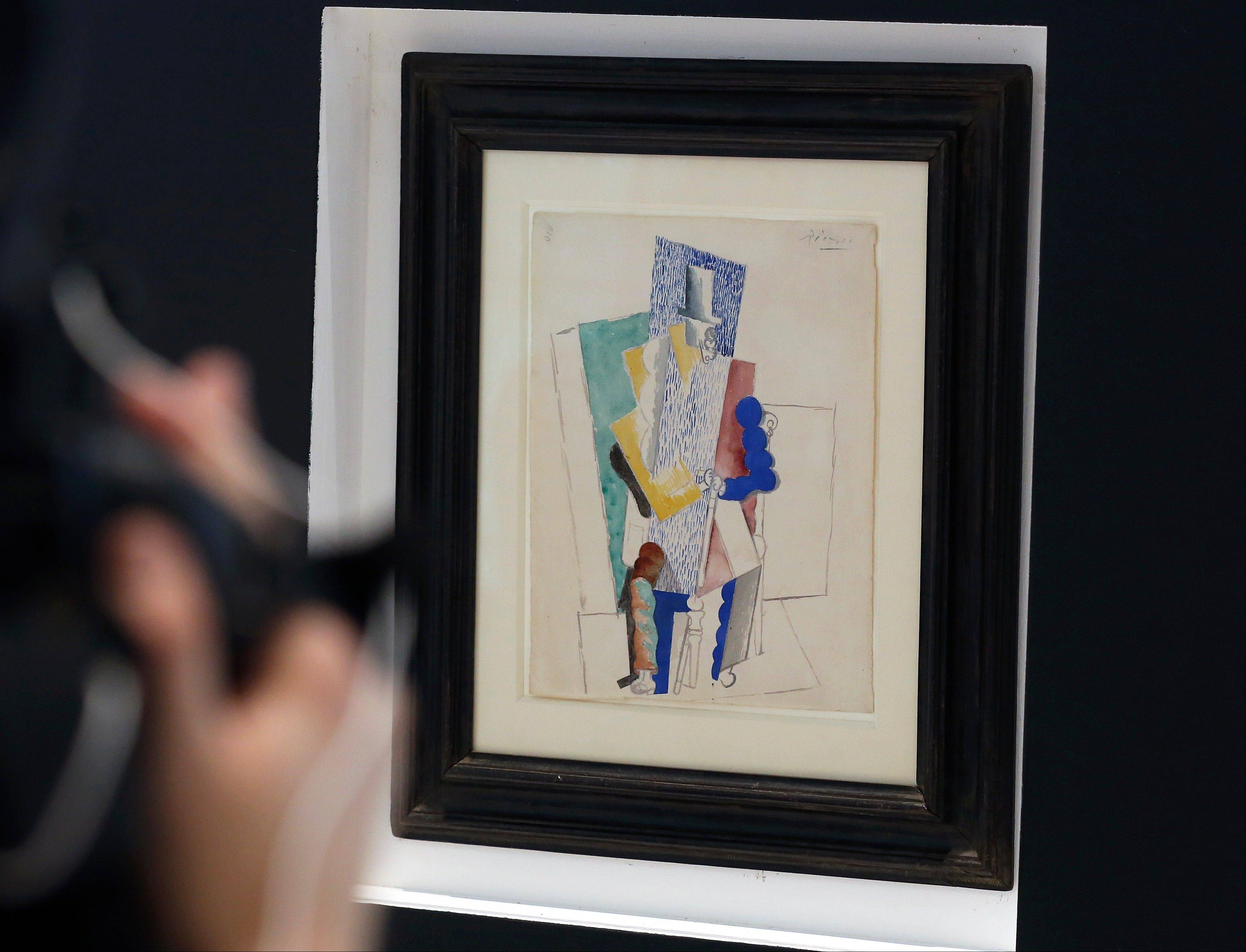 "Picasso's 1914 cubist drawing ""L'homme au Gibus,"" or ""Man in the Opera Hat,"" is presented at Sotheby's auction house in Paris."