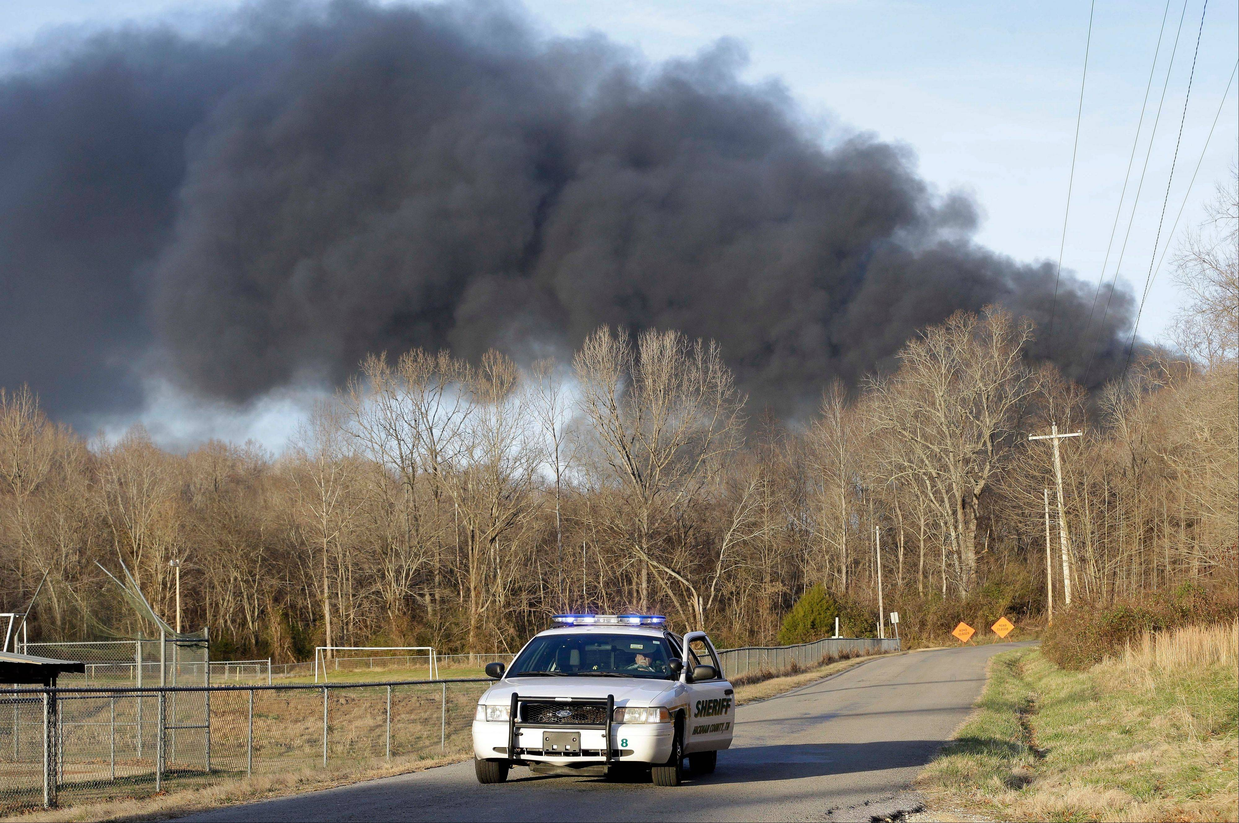 Smoke rises from a fire at a burning plastics recycling plant on a contaminated federal Superfund site on Wednesday, Dec. 18, 2013, near Lyles, Tenn. Officials evacuated area homes because they were concerned about toxic fumes.