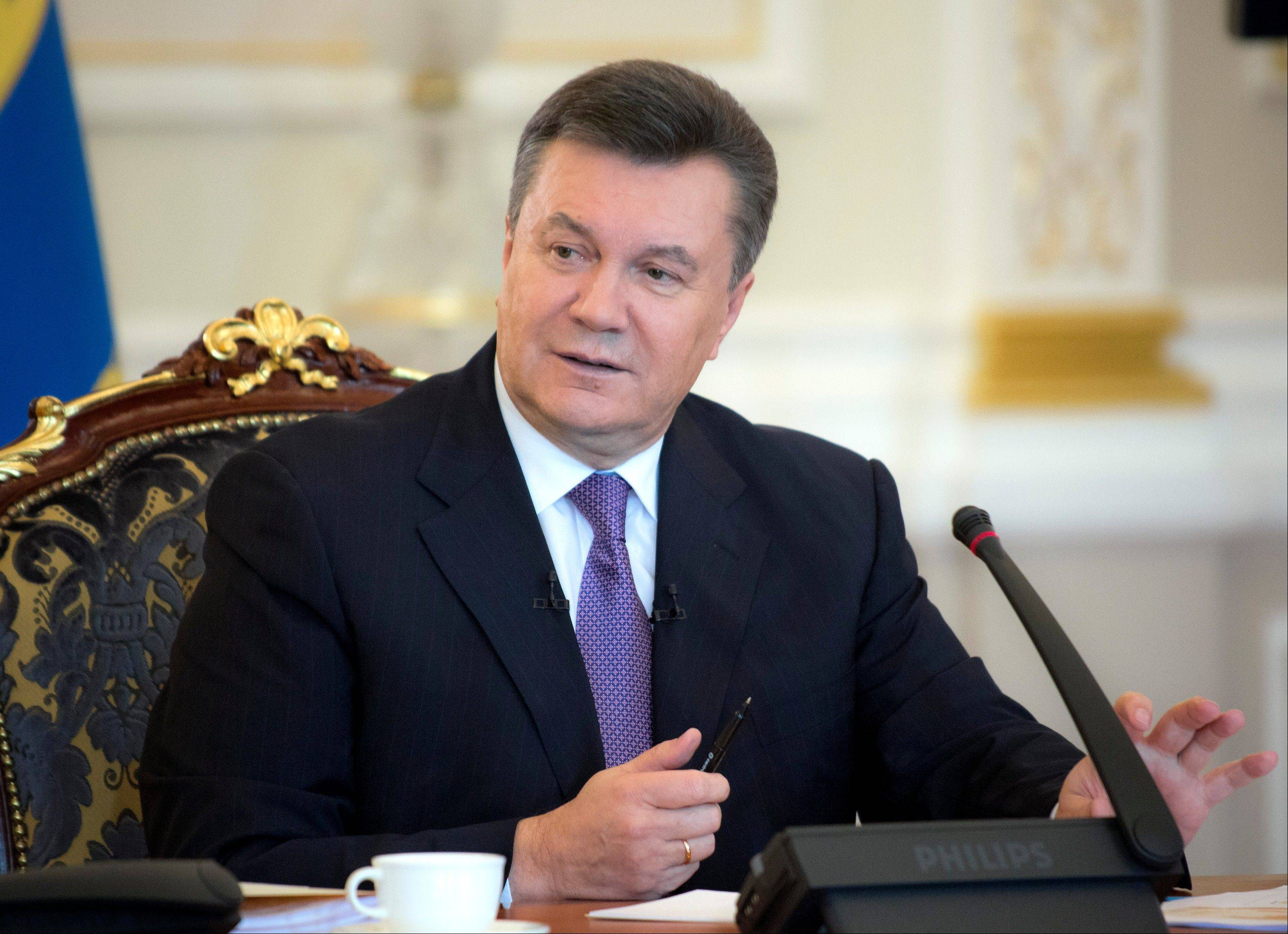 Ukrainian President Viktor Yanukovych faces massive street protests over his decision to spike a pact with the EU in favor of closer ties with Russia.