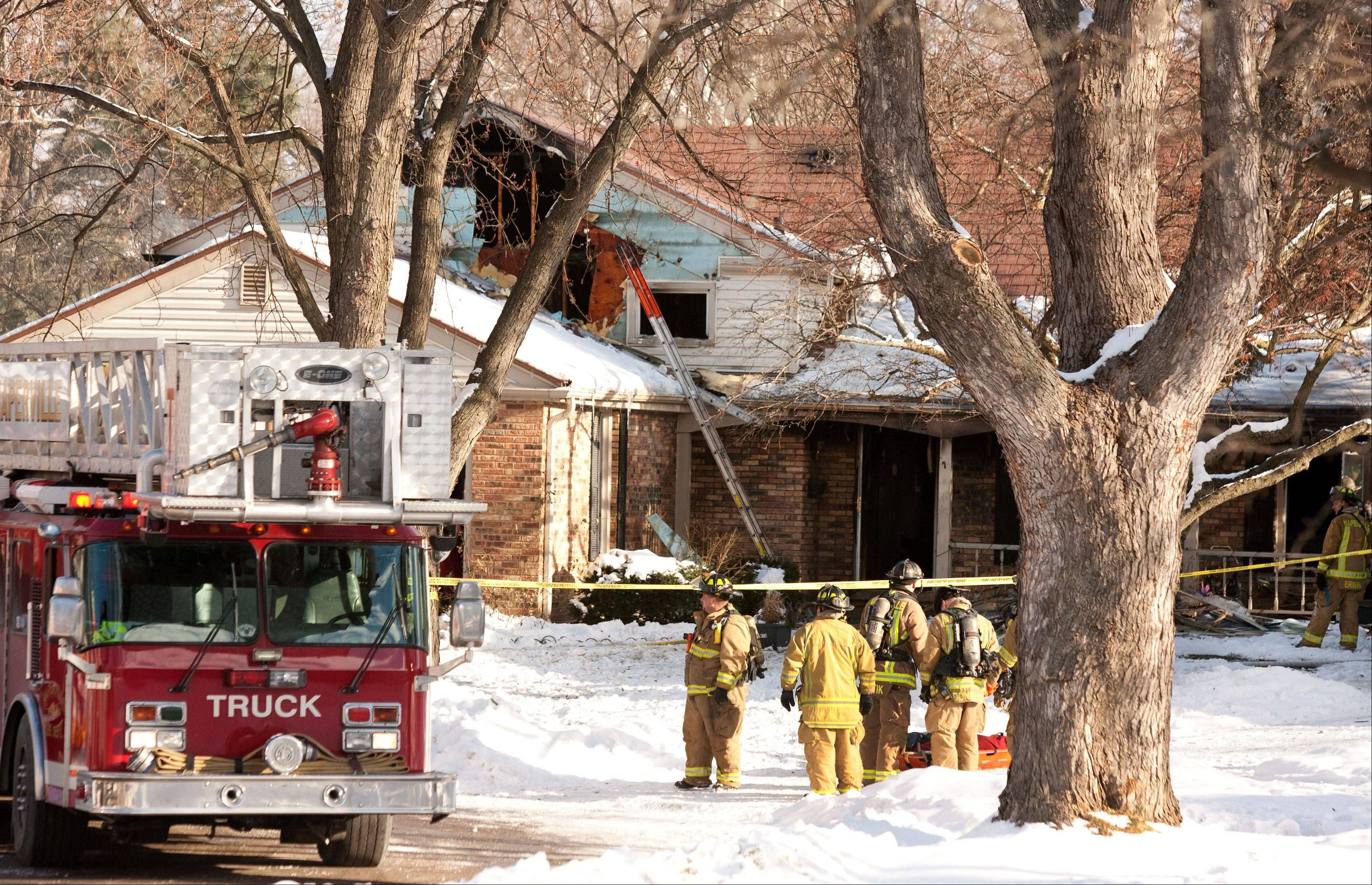 Naperville firefighters respond to a midmorning house fire on Field Court in Naperville.