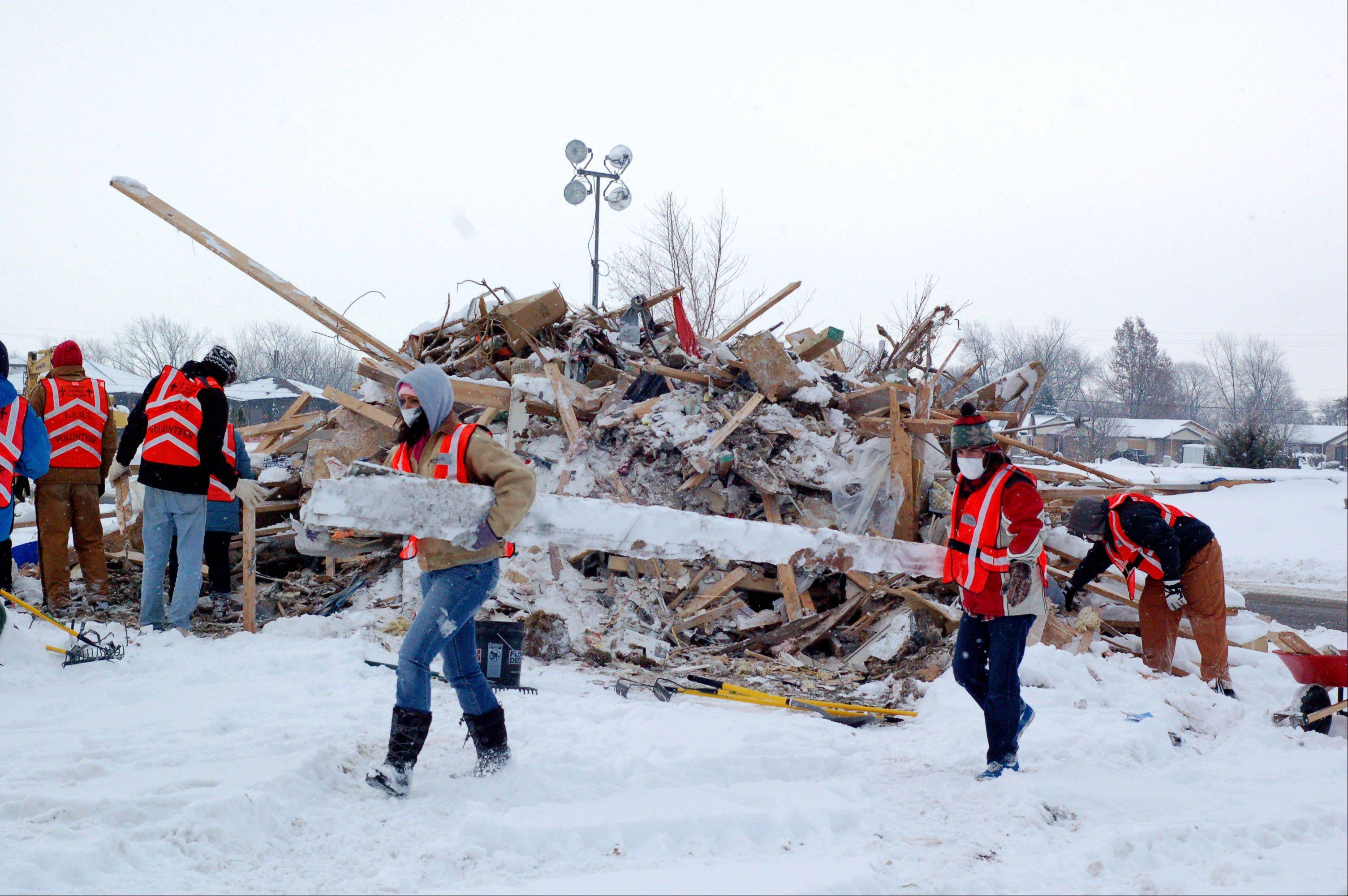 Judson University students and faculty helped clean up debris piles where homes were destroyed by the Nov. 17 tornado in Washington, Ill.