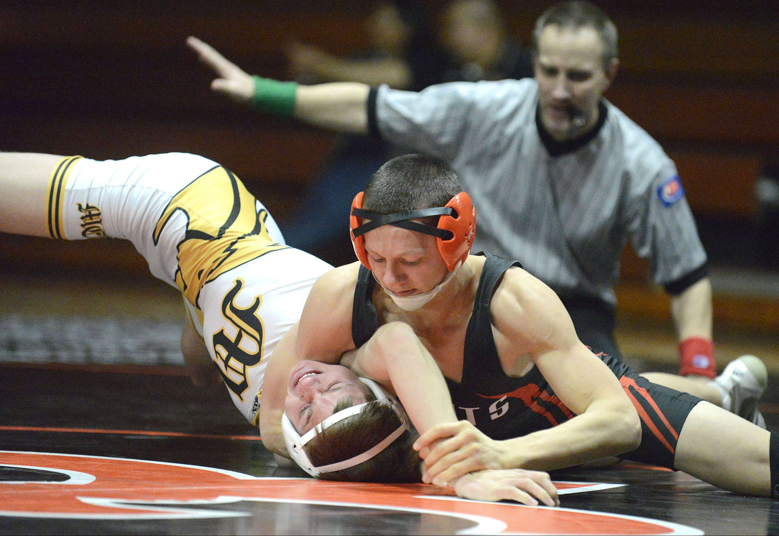 St. Charles East's Ryan Valesh won his 132-pound match over Metea Valley's David Veitch on Thursday in St. Charles.
