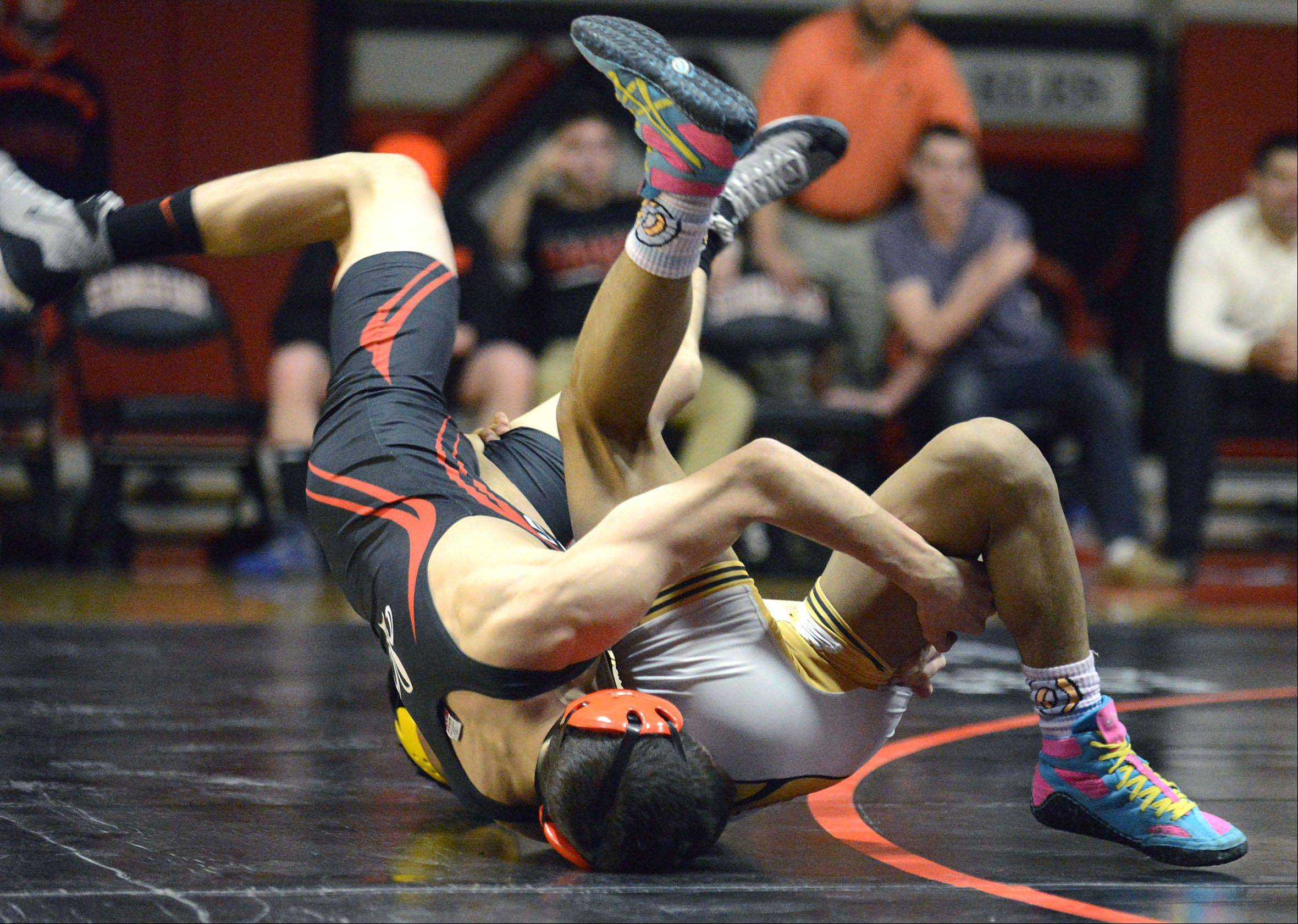 St. Charles East's Anthony Rubino flips Metea Valley's Axl Ariza during the 113 pound match on Thursday, December 19. Rubino took the win.