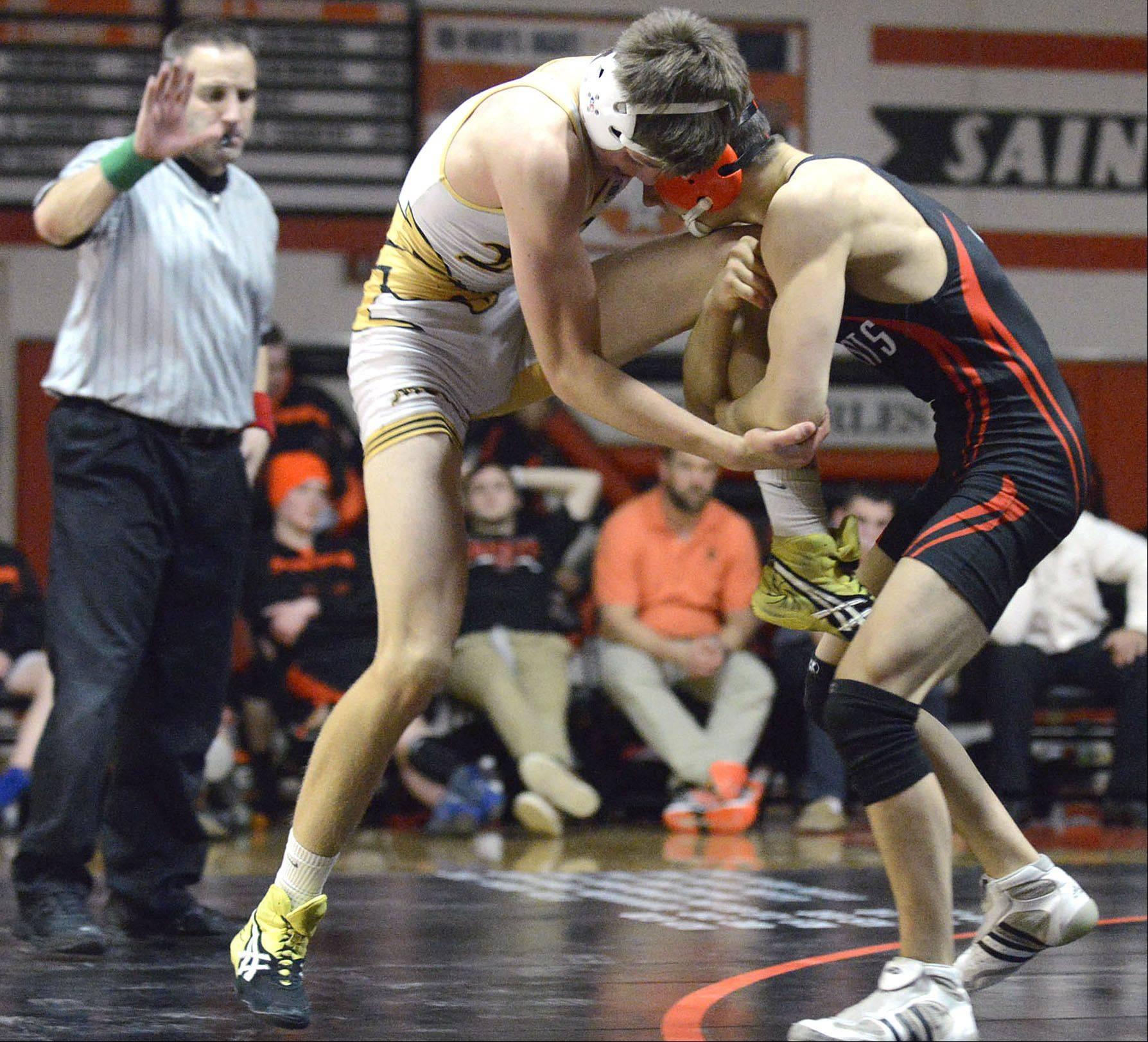 St. Charles East's Ryan Valesh takes the 132 pound match vs. Metea Valley's David Veitch on Thursday, December 19.