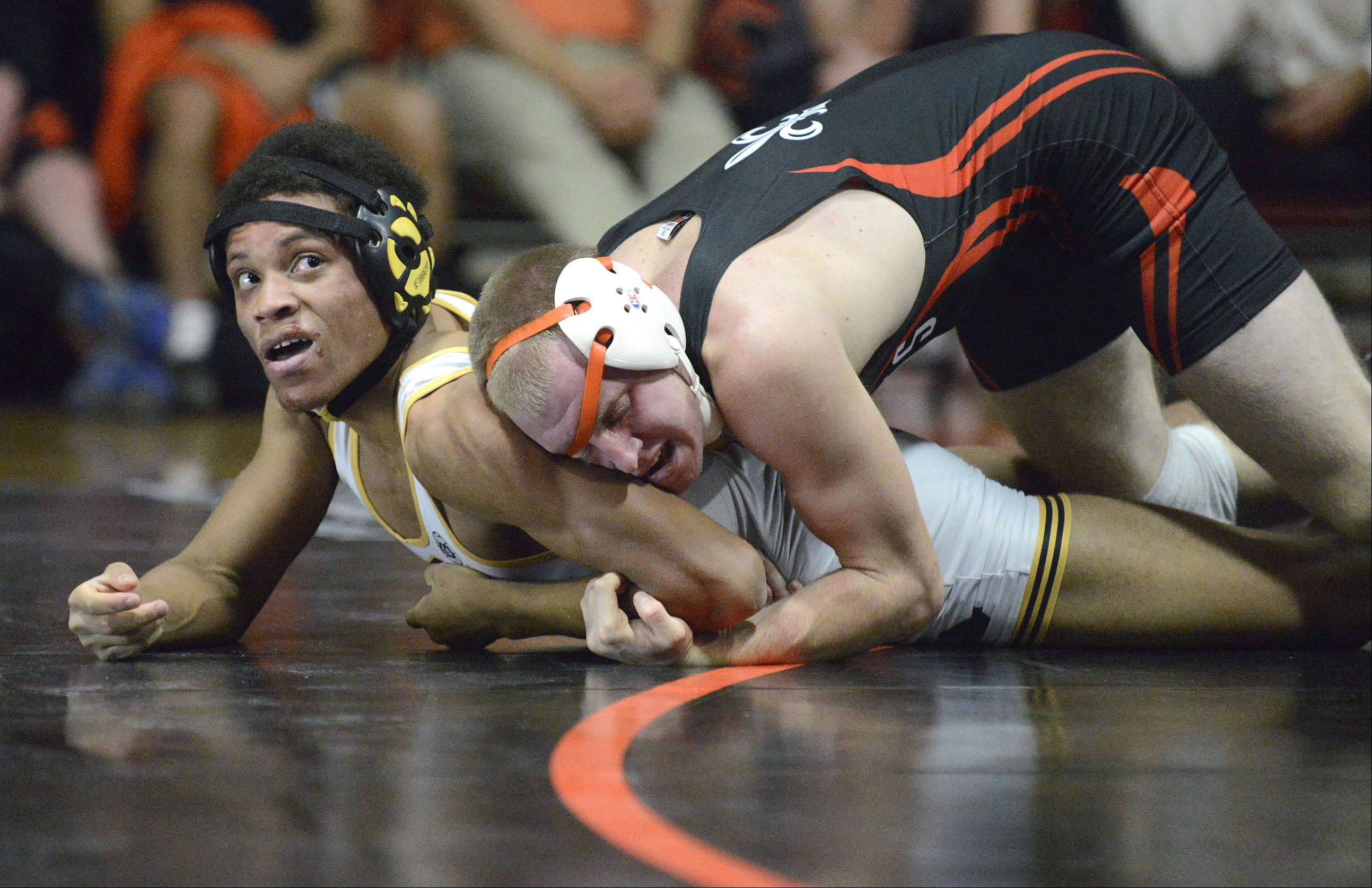 St. Charles East's Jake Mende takes the 145 pound match vs. Metea Valley's D.J. Materino on Thursday, December 19.