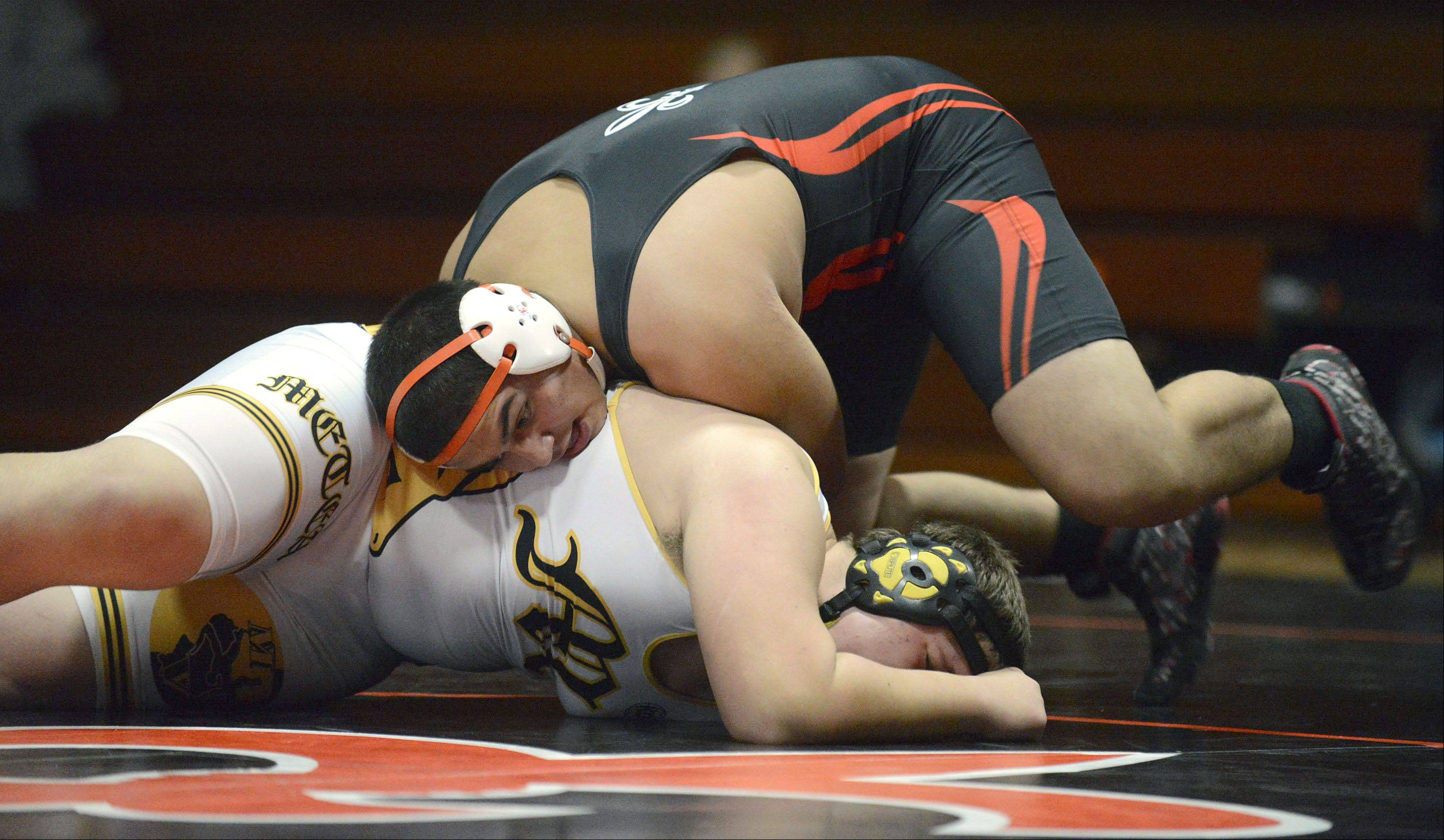 St. Charles East's Will Leite takes the win in the 285 pound match vs. Metea Valley's Bobby Papiernak on Thursday, December 19.