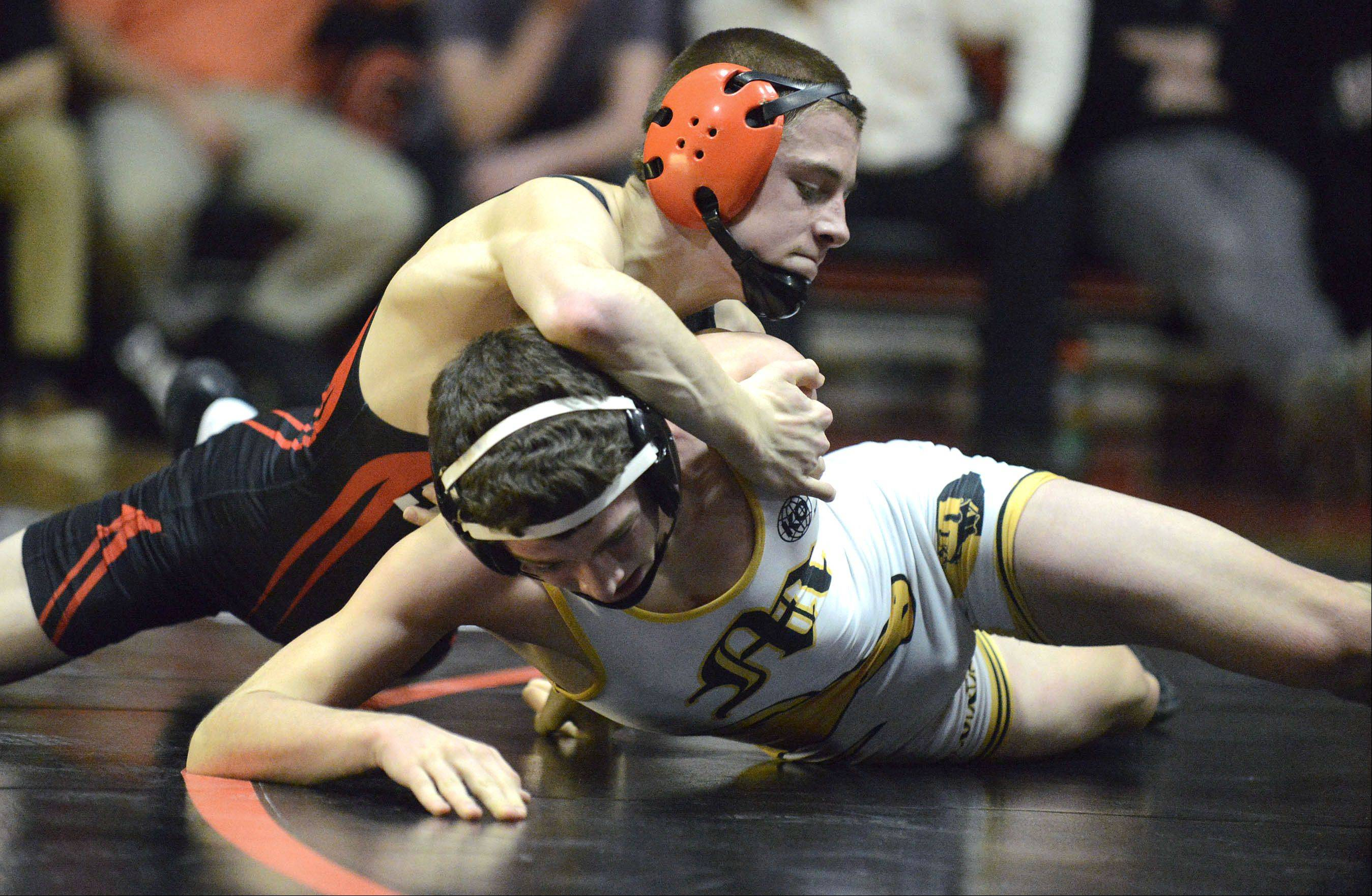 St. Charles East's DJ McDermott takes the win in the 120 pound match vs. Metea Valley's Jake Toepfer on Thursday, December 19.