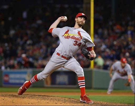 Reliever John Axford went a combined 7-7 with a 4.02 ERA in 75 appearances for the Brewers and Cardinals last season.