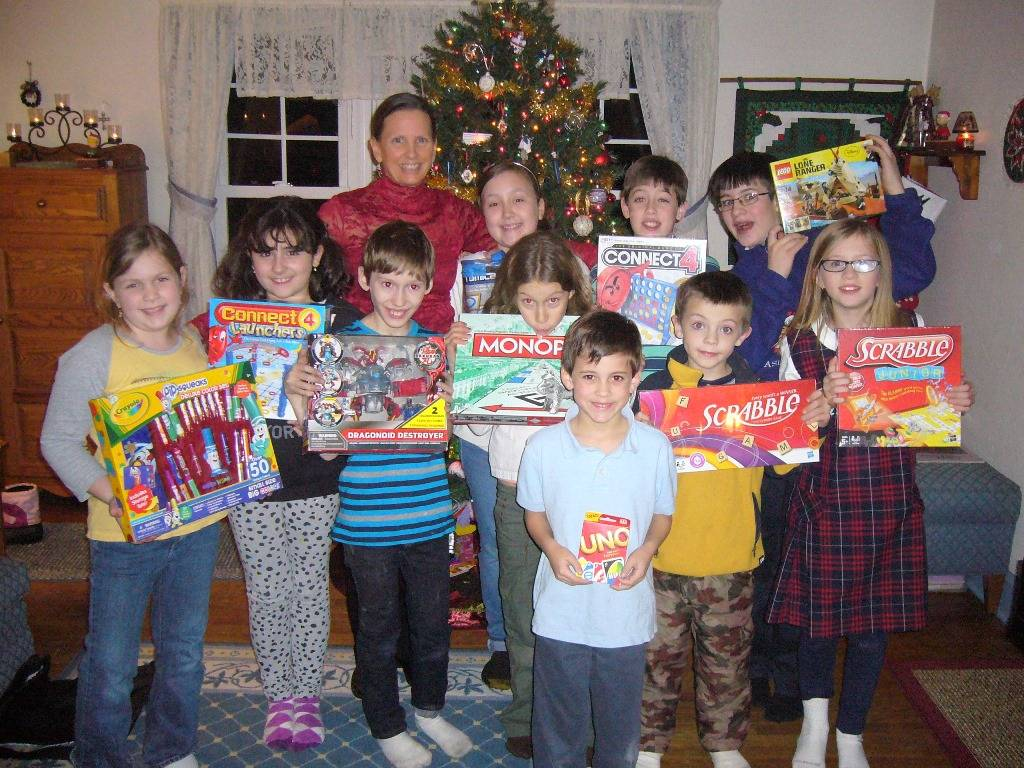 West Chicago resident and piano teacher Debi Inch, pictured with her students, organizes a toy drive through her studio to benefit the Toys for Tots program.